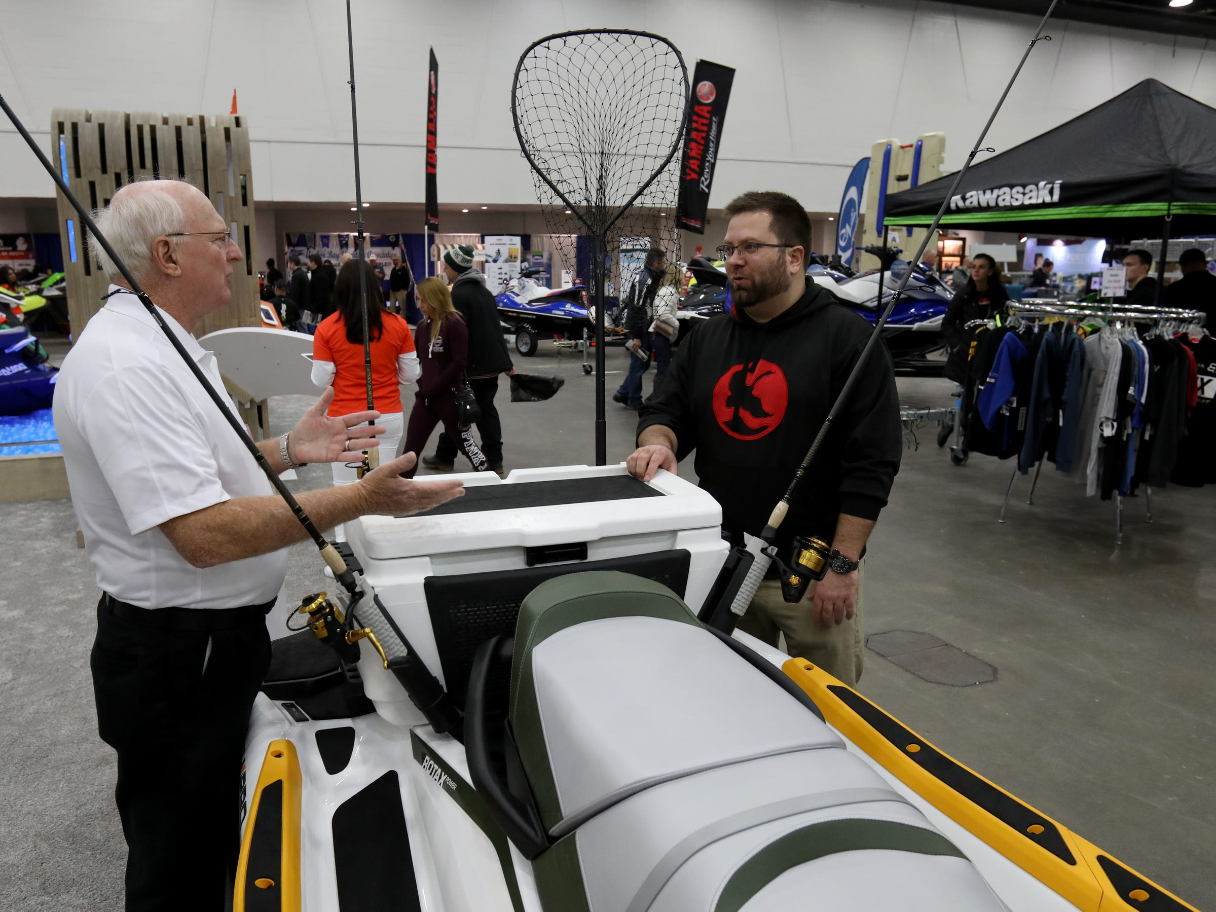 (L to R) See-Doo product specialist Ted McKercher and Nick Carnacchi, 33 of West Bloomfield talk about See-Doo's new Fish Pro jet ski that has been outfitted for fishing. It was one of many personal watercraft on display during the Detroit Boat Show at Cobo Center in Detroit on Saturday, February 16, 2019.Carnacchi has a See-Doo RXTX and outfitted it with fishing poles and a water cooler to store fish and loves the idea of a jet ski purposely built for fishing..