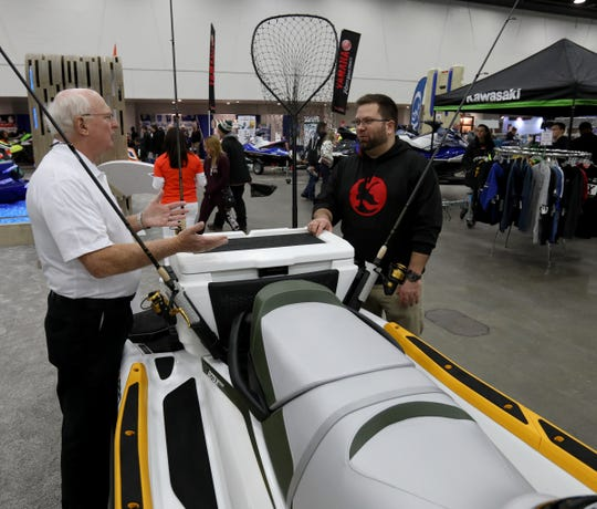 (L to R) See-Doo product specialist Ted McKercher and Nick Carnacchi, 33 of West Bloomfield talk about See-Doo's new Fish Pro jet ski that has been outfitted for fishing. It was one of many personal watercraft on display during the Detroit Boat Show at Cobo Center in Detroit on Saturday, February 16, 2019.