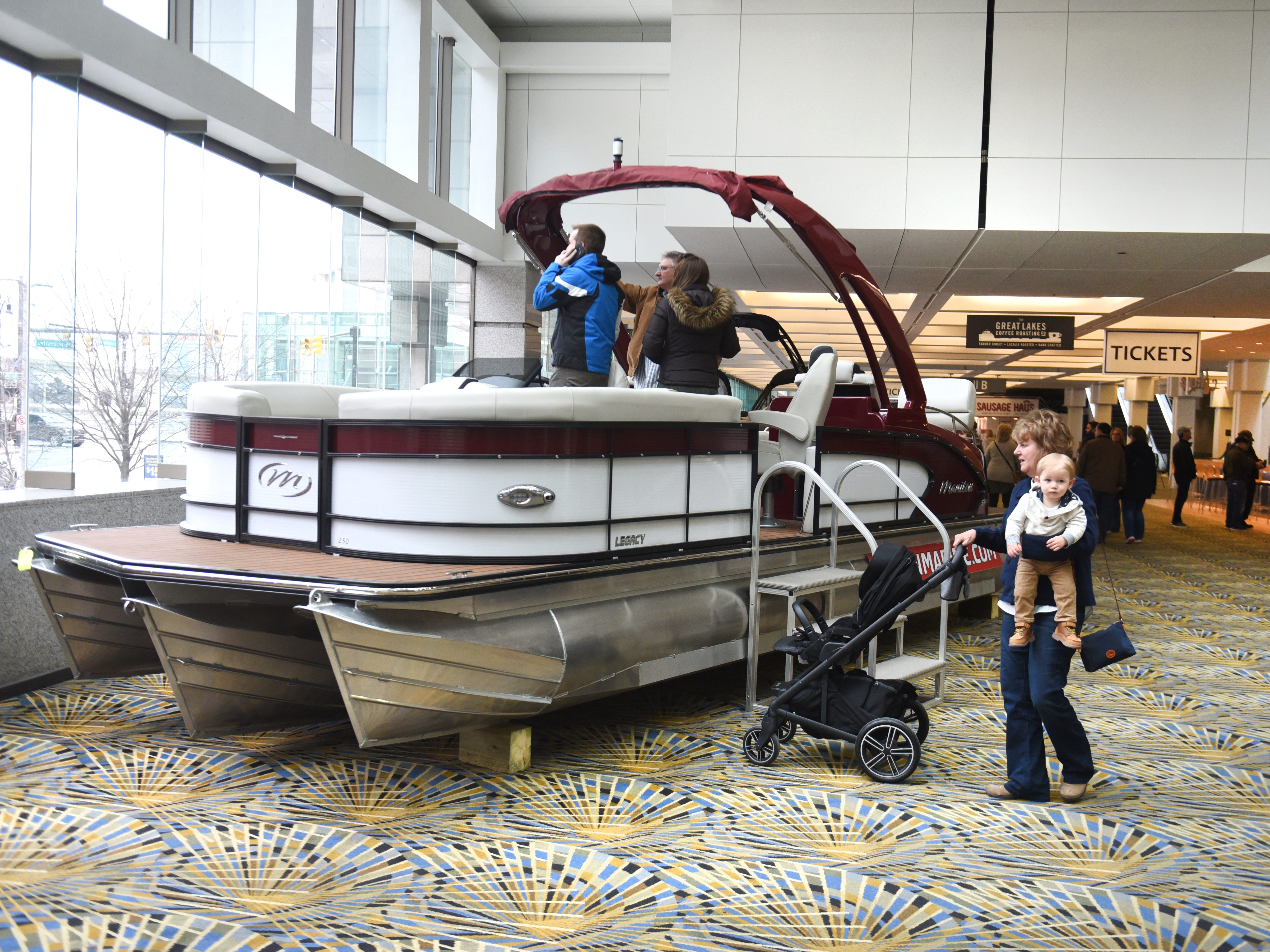 One of the many pontoon boat's on display at the Detroit Boat Show at Cobo Center in Detroit on Saturday.