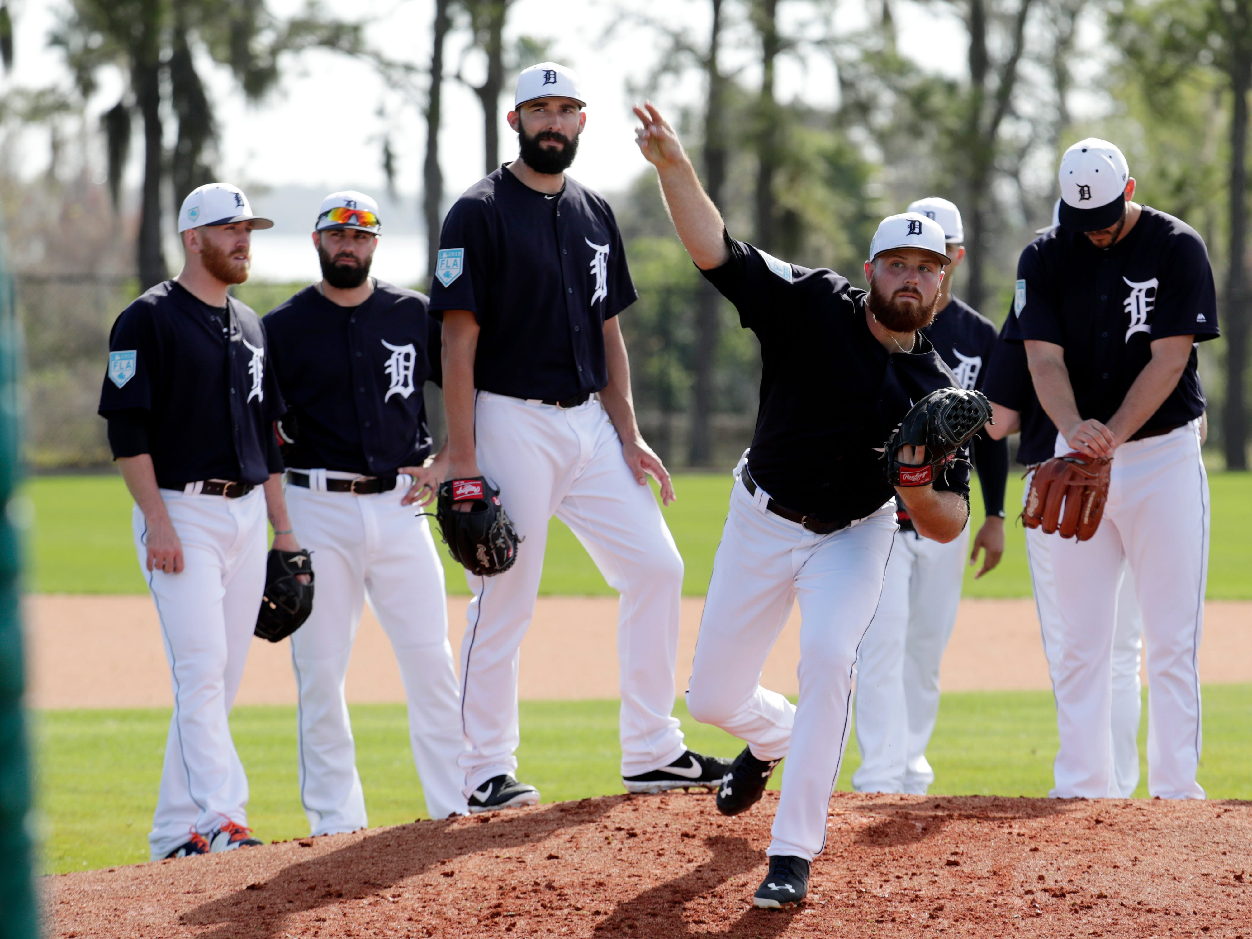 Detroit Tigers relief pitcher Buck Farmer works on a drill at the Tigers spring training baseball facility, Friday, Feb. 15, 2019, in Lakeland, Fla. (AP Photo/Lynne Sladky)