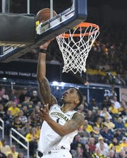 Michigan's Charles Matthews lays in two points on a long pass from Ignas Brazdeikis in the first half.  Matthews finished with 14 points as the Wolverines opened on a 14-2 run en route to a 65-52 victory Saturday over the Terrapins at Crisler Center.