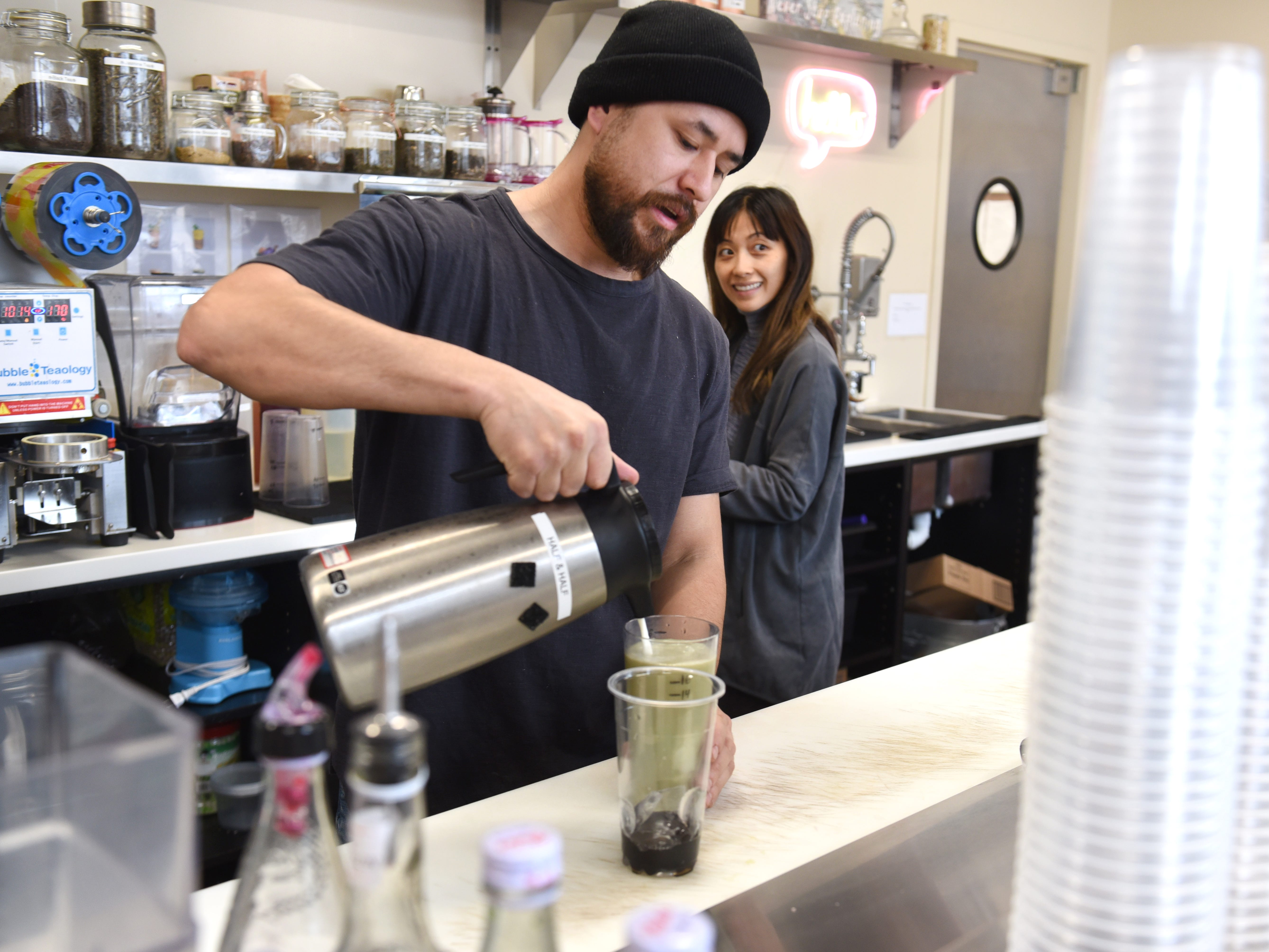 Cedric Lee, left, and his wife, Gowhnou, owners of Tou & Mai, make a honey dew sweet boba drink on Wednesday, Feb. 5, 2019 at the midtown Detroit store.