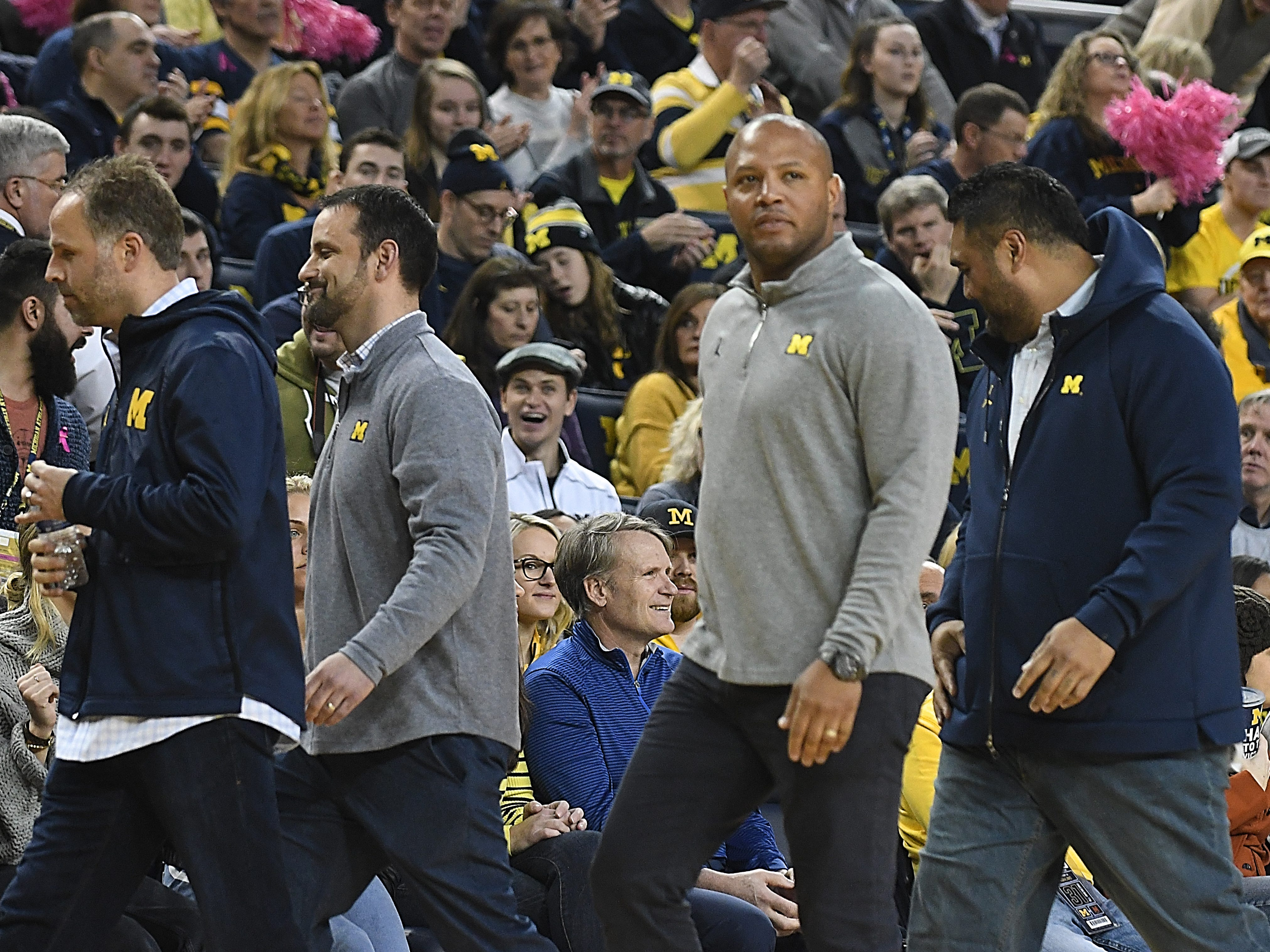 New Michigan football coaches quarterbacks coach Ben McDaniels, defensive backs coach Anthony Campanile, offensive coordinator Josh Gattis and defensive line coach Shaun Nua are introduced during a break in the game.