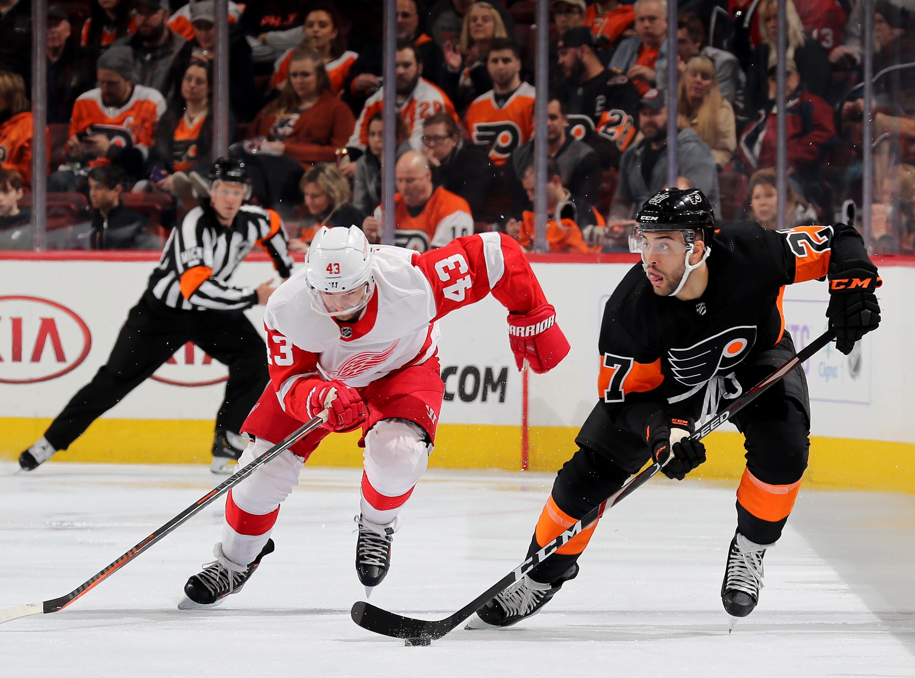 PHILADELPHIA, PENNSYLVANIA - FEBRUARY 16:   Justin Bailey #27 of the Philadelphia Flyers takes the puck as Darren Helm #43 of the Detroit Red Wings defends in the second period at Wells Fargo Center on February 16, 2019 in Philadelphia, Pennsylvania. (Photo by Elsa/Getty Images)