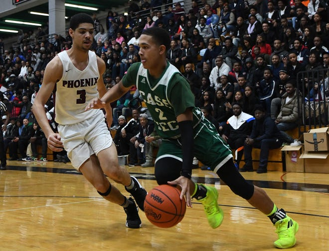 Cass Tech's Anthony Kyles drives the baseline and lays up two points against Renaissance's Chandler Turner in the second half.