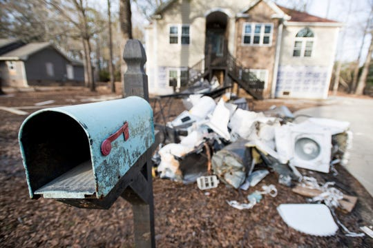 A mailbox stands in front of a a home damaged by flooding from Hurricane Florence near the Crabtree Swamp\\.. According to homeowner in the neighborhood, the home has been purchased by F.E.M.A. and is scheduled to be demolished.