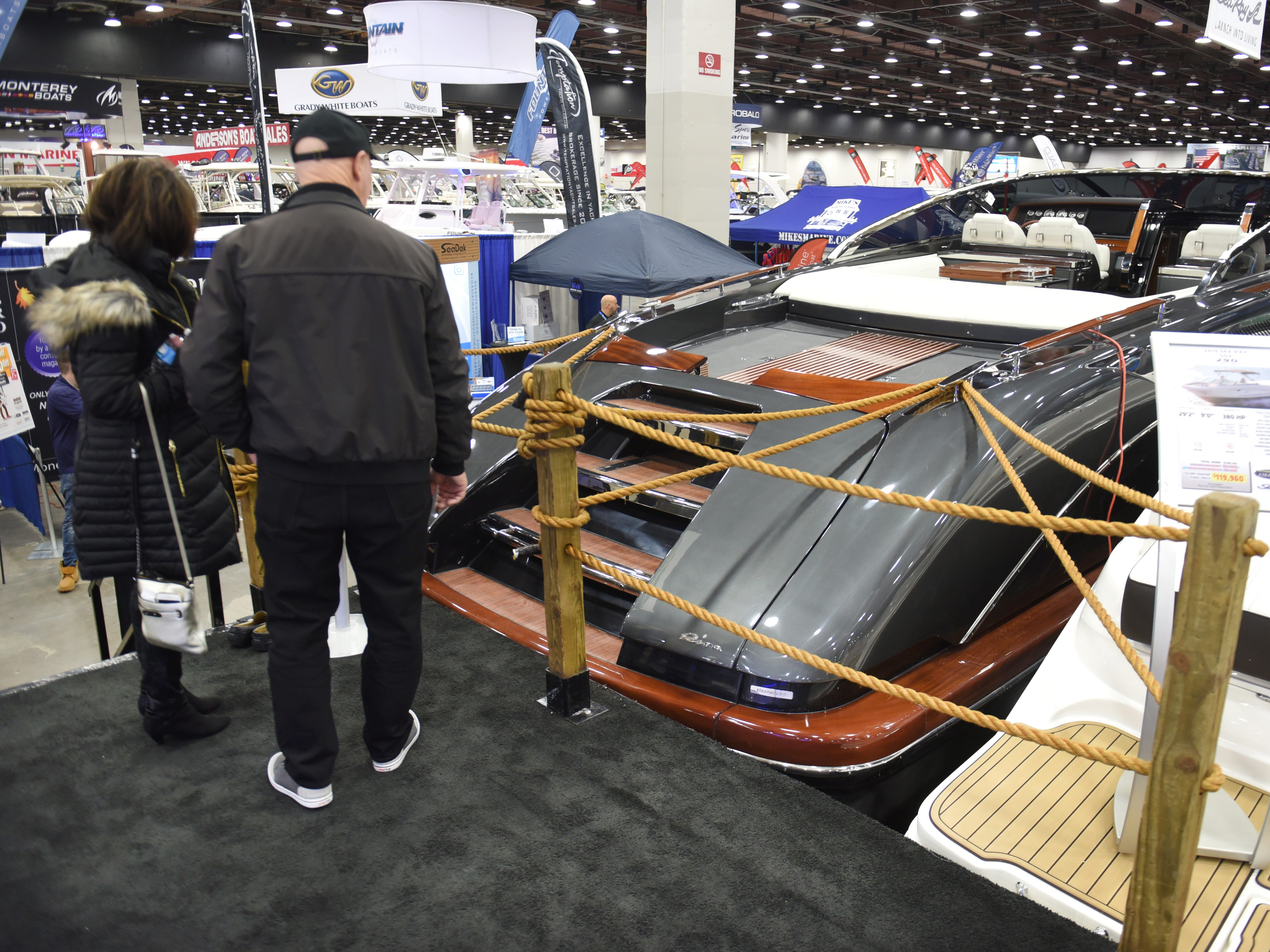 People look at the 2017 Rivamare with a price of $1,095.000 at the Detroit Boat Show at Cobo Center in Detroit on Saturday.