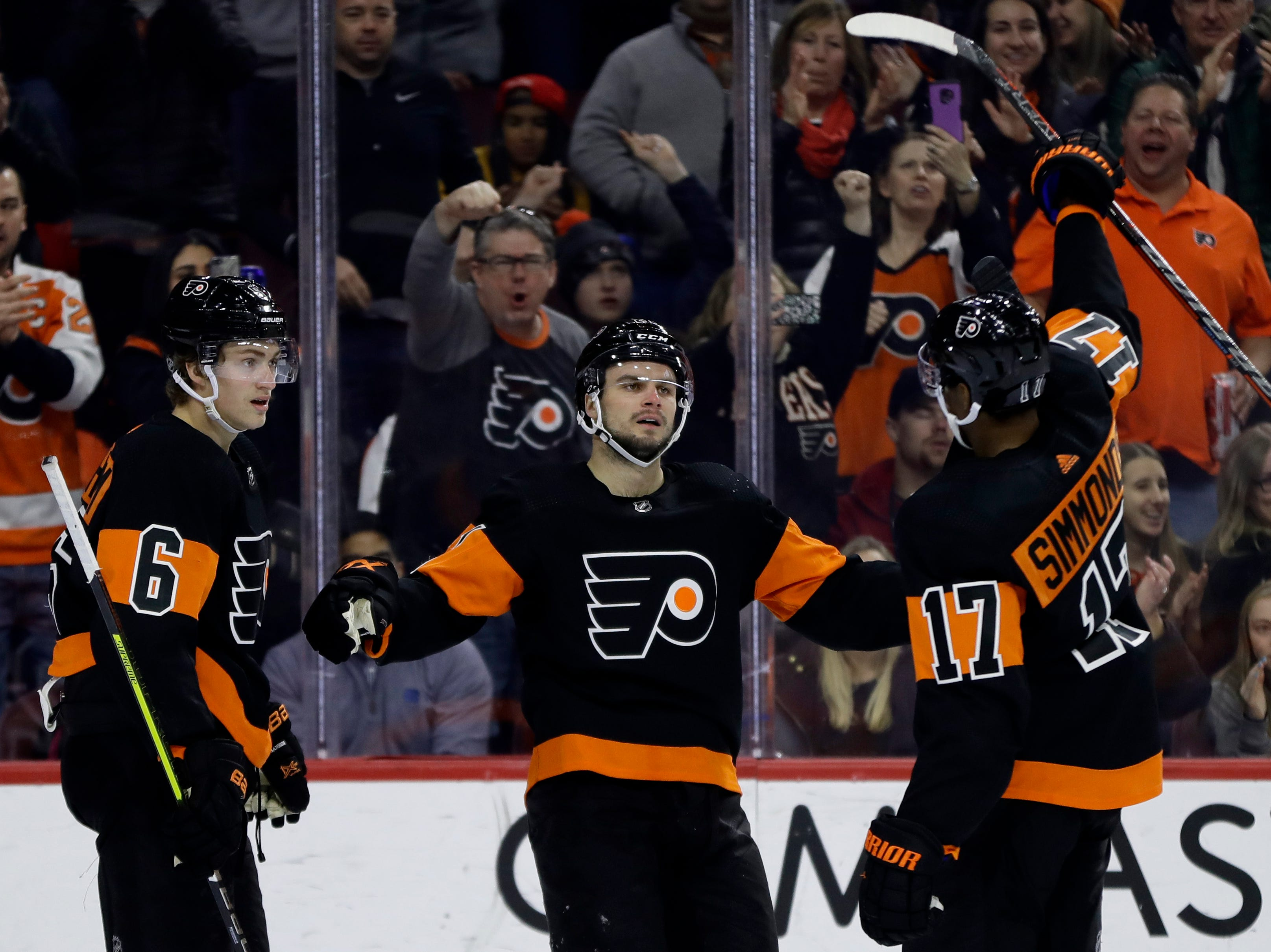 Philadelphia Flyers' Travis Sanheim (6), Scott Laughton (21) and Wayne Simmonds (17) celebrate after Laughton's goal during the second period of an NHL hockey game against the Detroit Red Wings, Saturday, Feb. 16, 2019, in Philadelphia. (AP Photo/Matt Slocum)