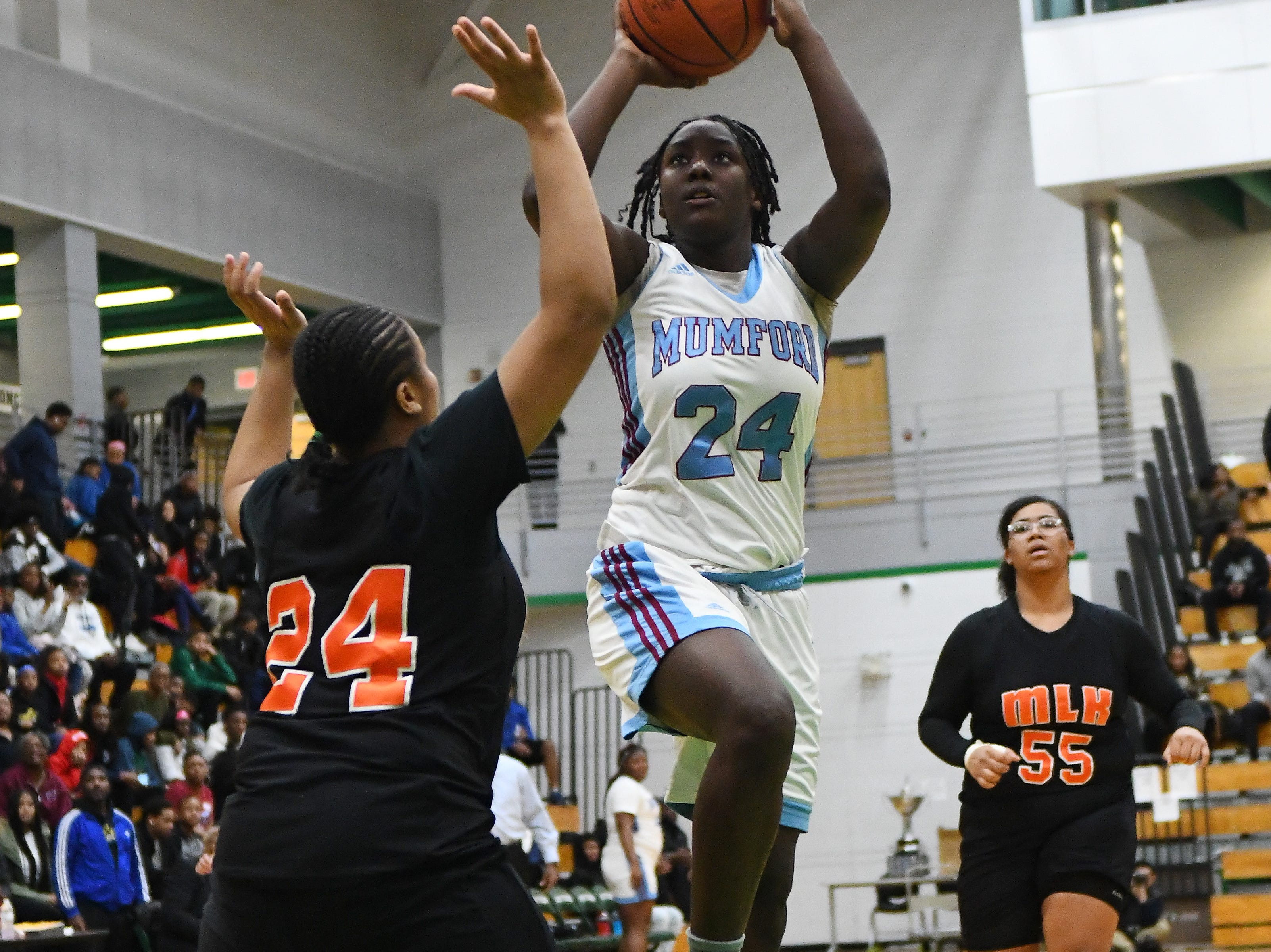 Mumford's Ajanee Horton puts up a shot against King's Danielle Camp in the first half.