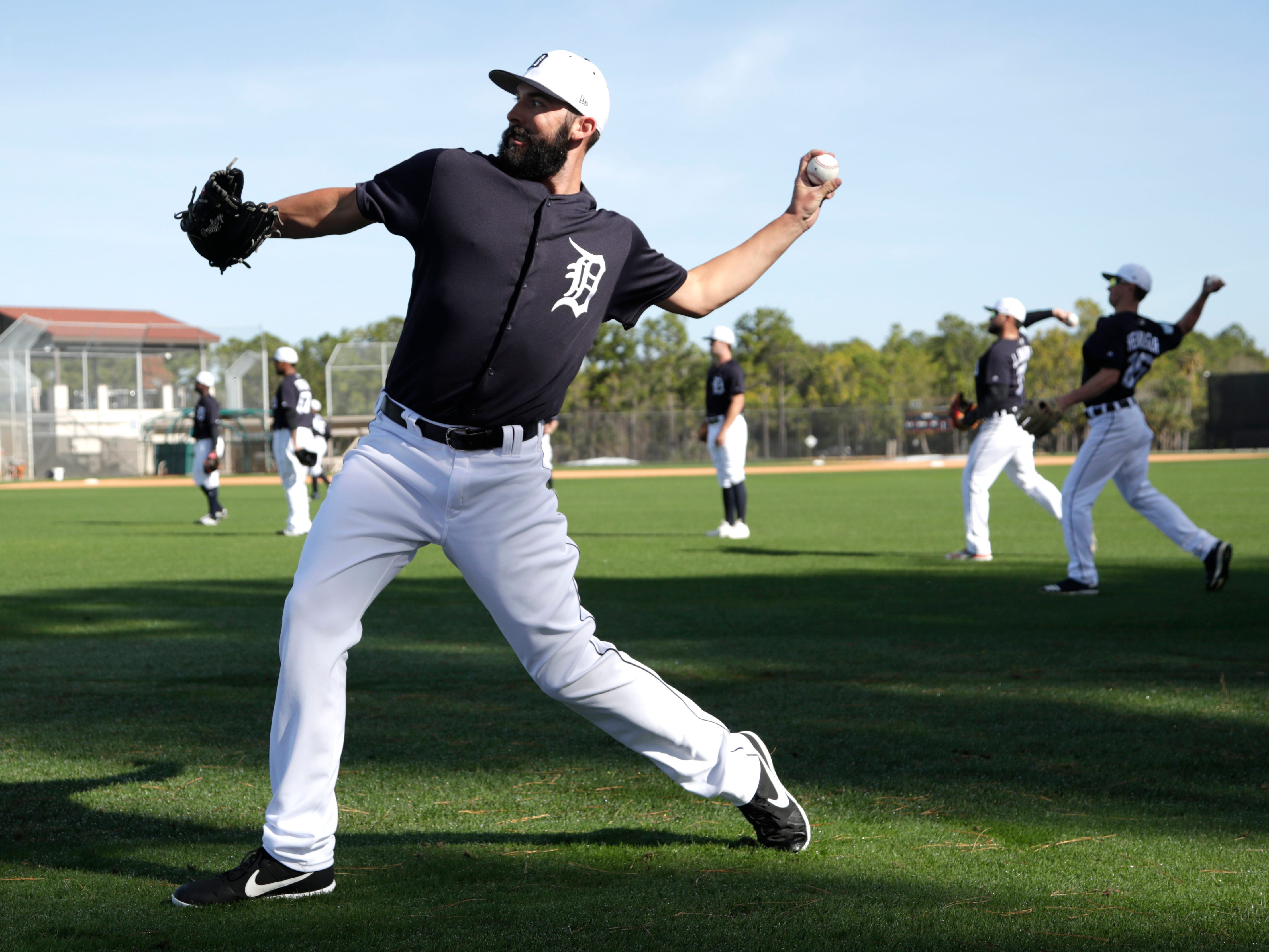Detroit Tigers pitcher Ryan Carpenter does drills.
