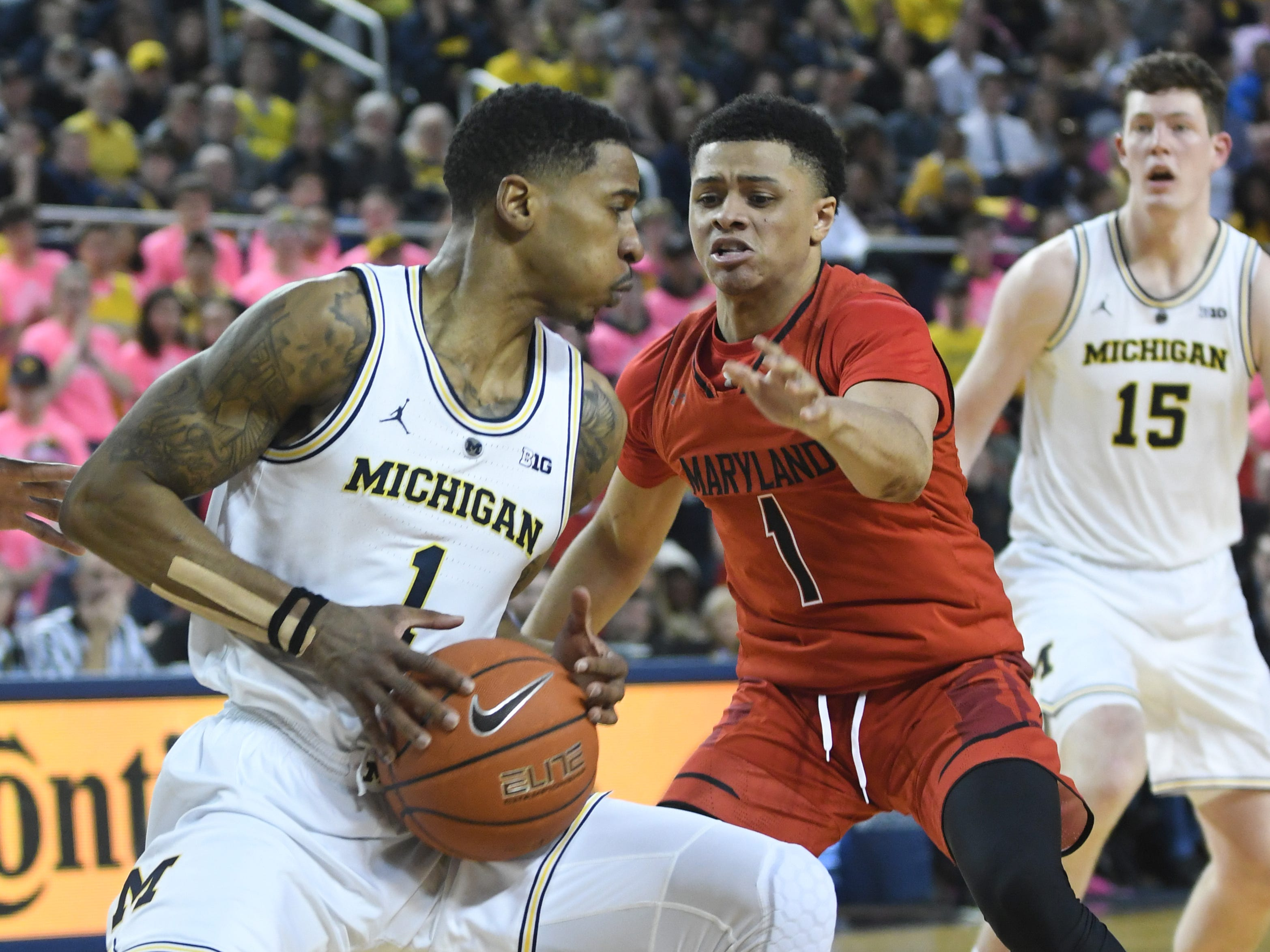 Michigan's Charles Matthews works against Maryland's Anthony Cowan Jr. in the second half.