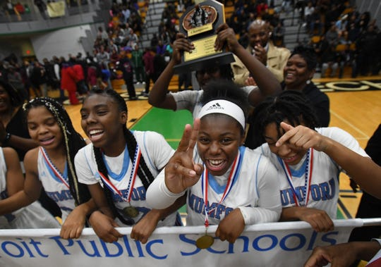 Sequoia Jackson, Keara Wilson, Coreen Yharborugh and Tiaira Earnest celebrate with teammates after winning back-to-back PSL Championships.