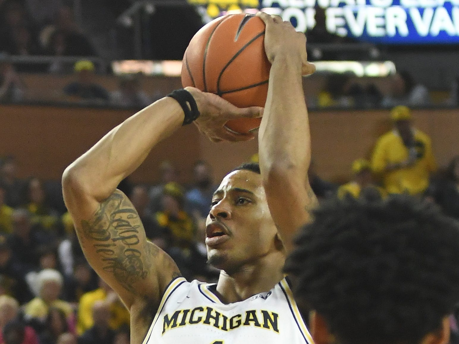 Michigan's Charles Matthews puts up a shot in the second half.