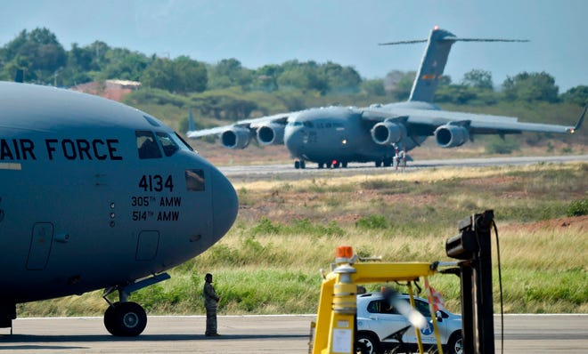 US Air Force C-17 aircrafts carrying humanitarian aid for Venezuela are seen after landing at Camilo Daza International Airport in Cucuta, Colombia, on the border with Venezuela on February 16, 2019.