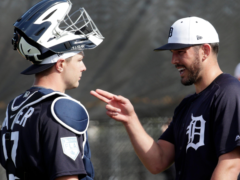 Detroit Tigers pitcher Drew VerHagen, right, talks with catcher Grayson Greiner.