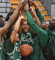 Cass Tech's Daniel Autrey, center, and his teammates celebrate after a 80-56 victory over Renaissance High in the Detroit PSL championship game Friday.