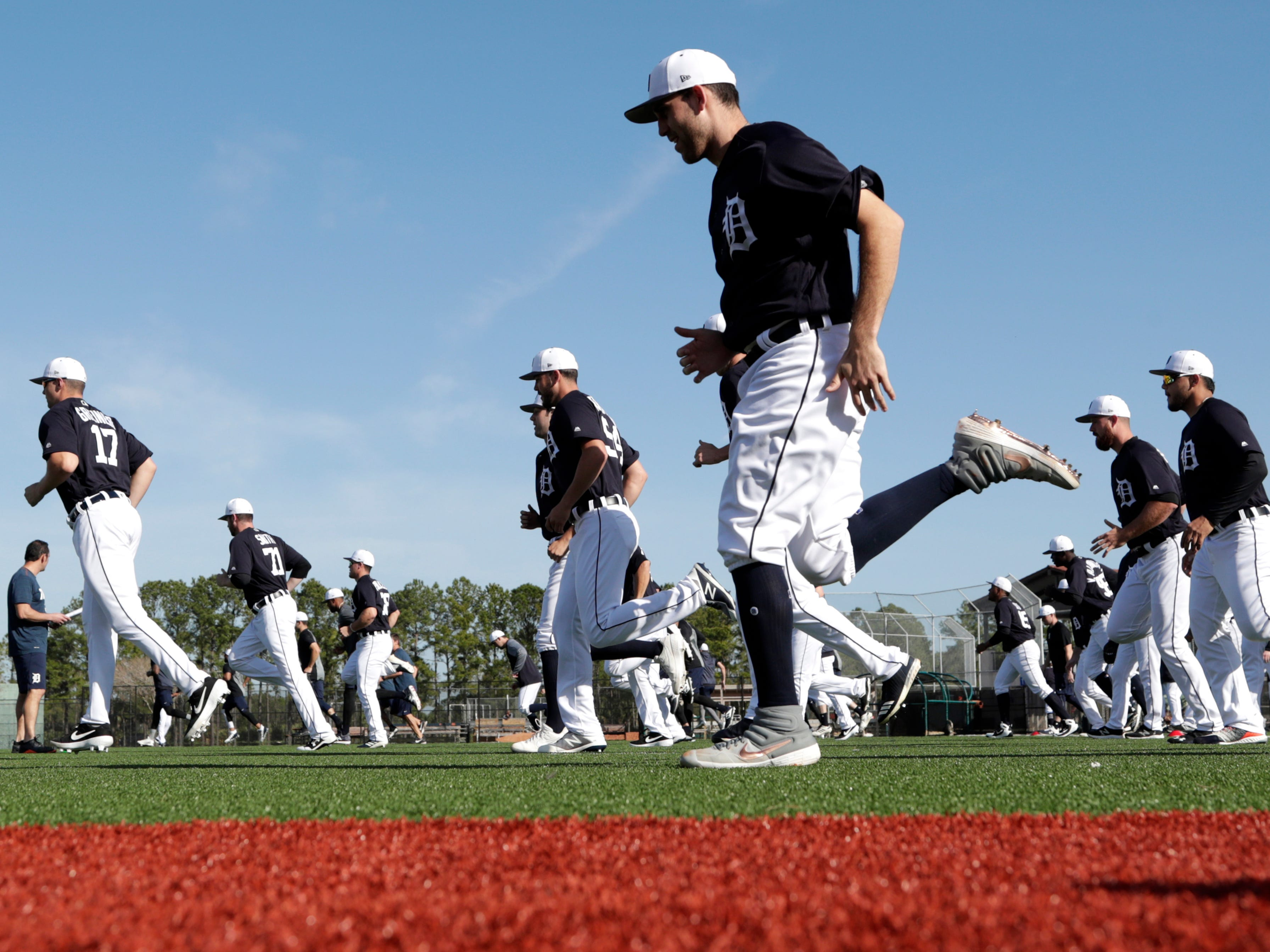 Detroit Tigers starting pitcher Matthew Boyd, center, loosens up at the Detroit Tigers spring training baseball facility.