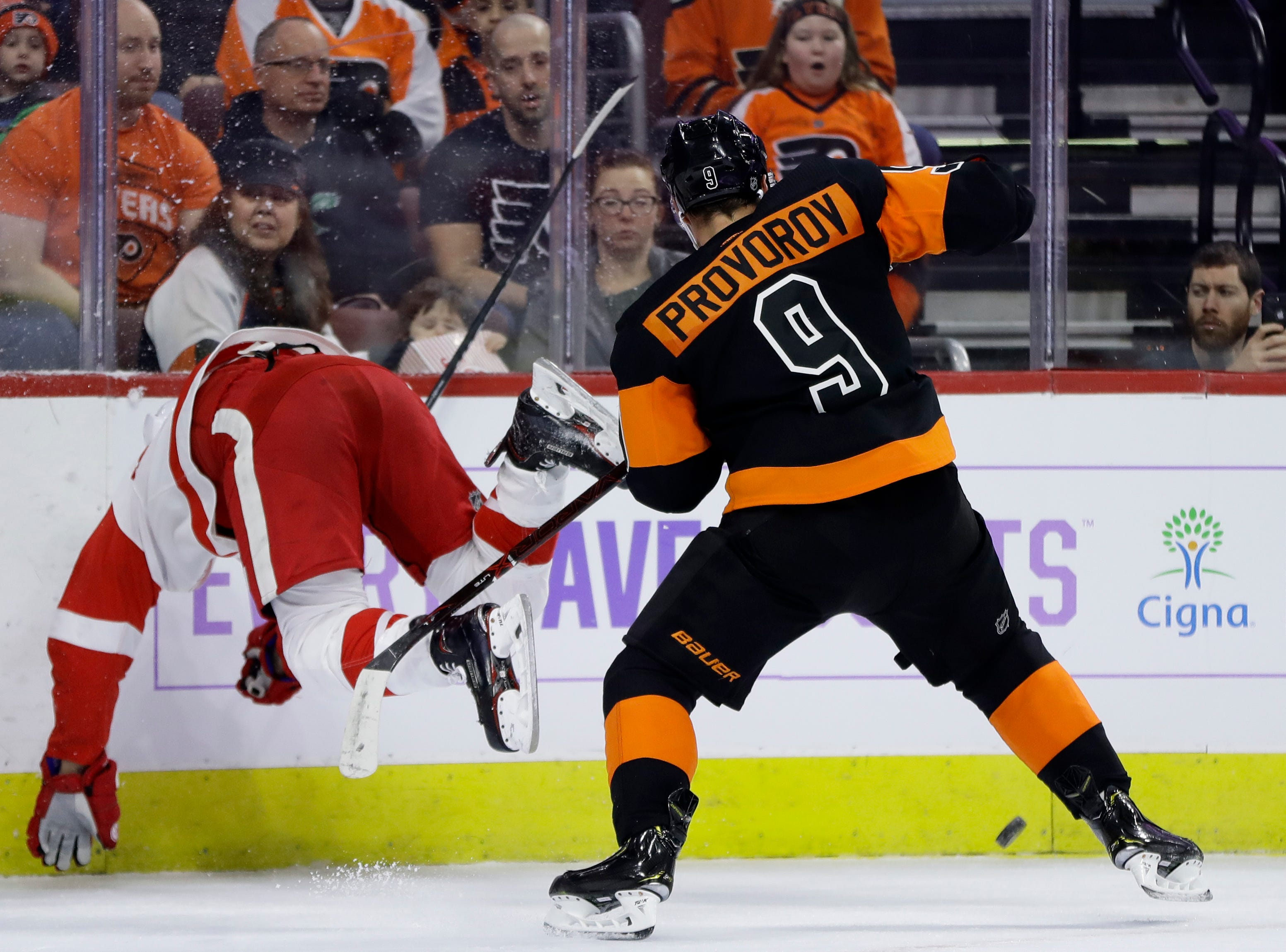 Detroit Red Wings' Justin Abdelkader, left, goes flying after trying to check Philadelphia Flyers' Ivan Provorov during the first period of an NHL hockey game, Saturday, Feb. 16, 2019, in Philadelphia. (AP Photo/Matt Slocum)