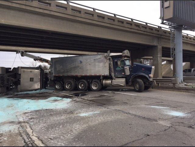 Troy police say the truck overturned and spilled 50 tons of rock salt Saturday.
