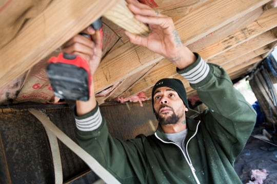 Joshua Voaklander works to repair his home damaged by flooding from Hurricane Florence. Voaklander says that if floodwaters come inside the house again, he is moving.