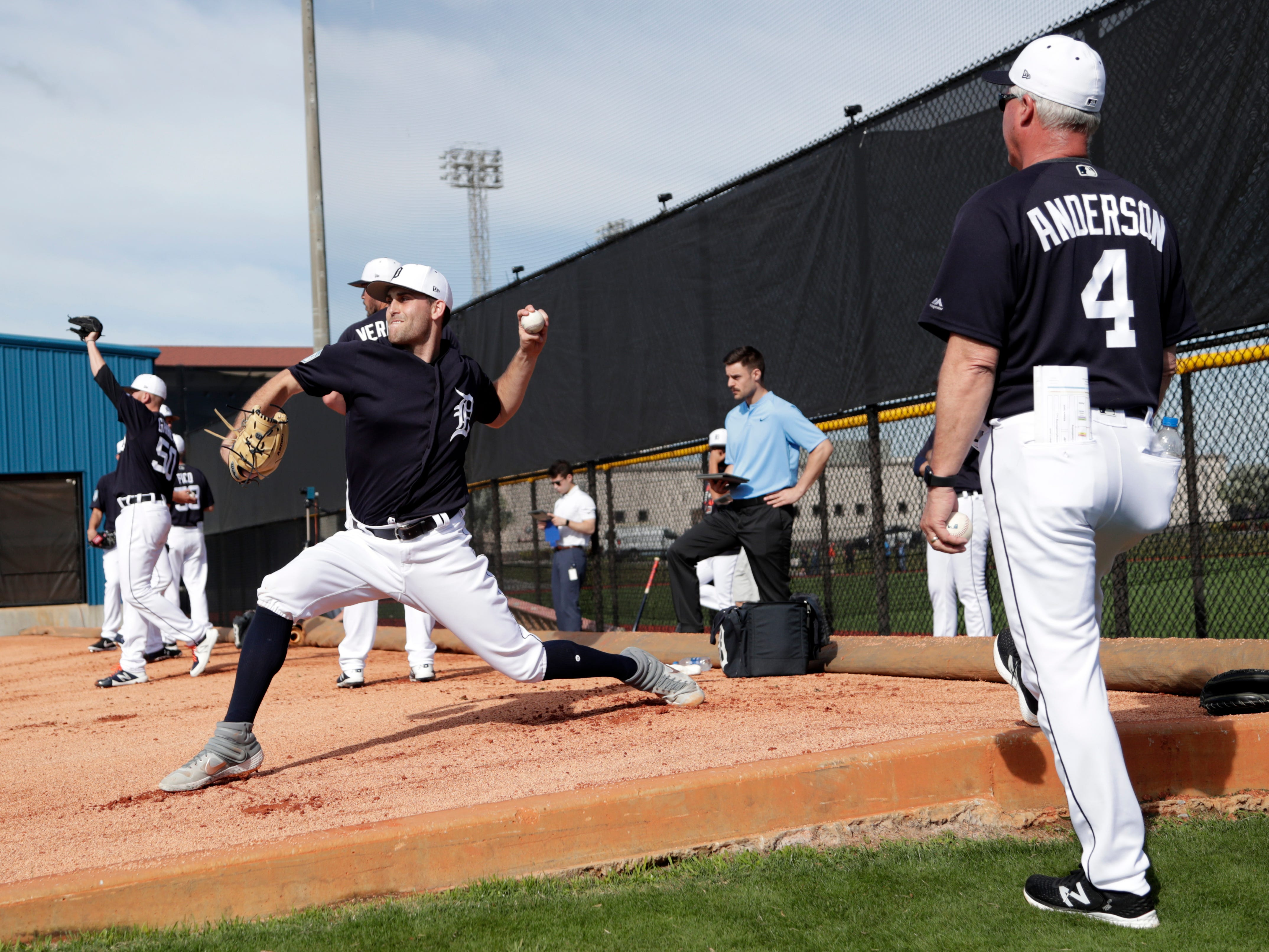 Detroit Tigers starting pitcher Matthew Boyd throws in the bullpen as pitching coach Rick Anderson (4) looks on.