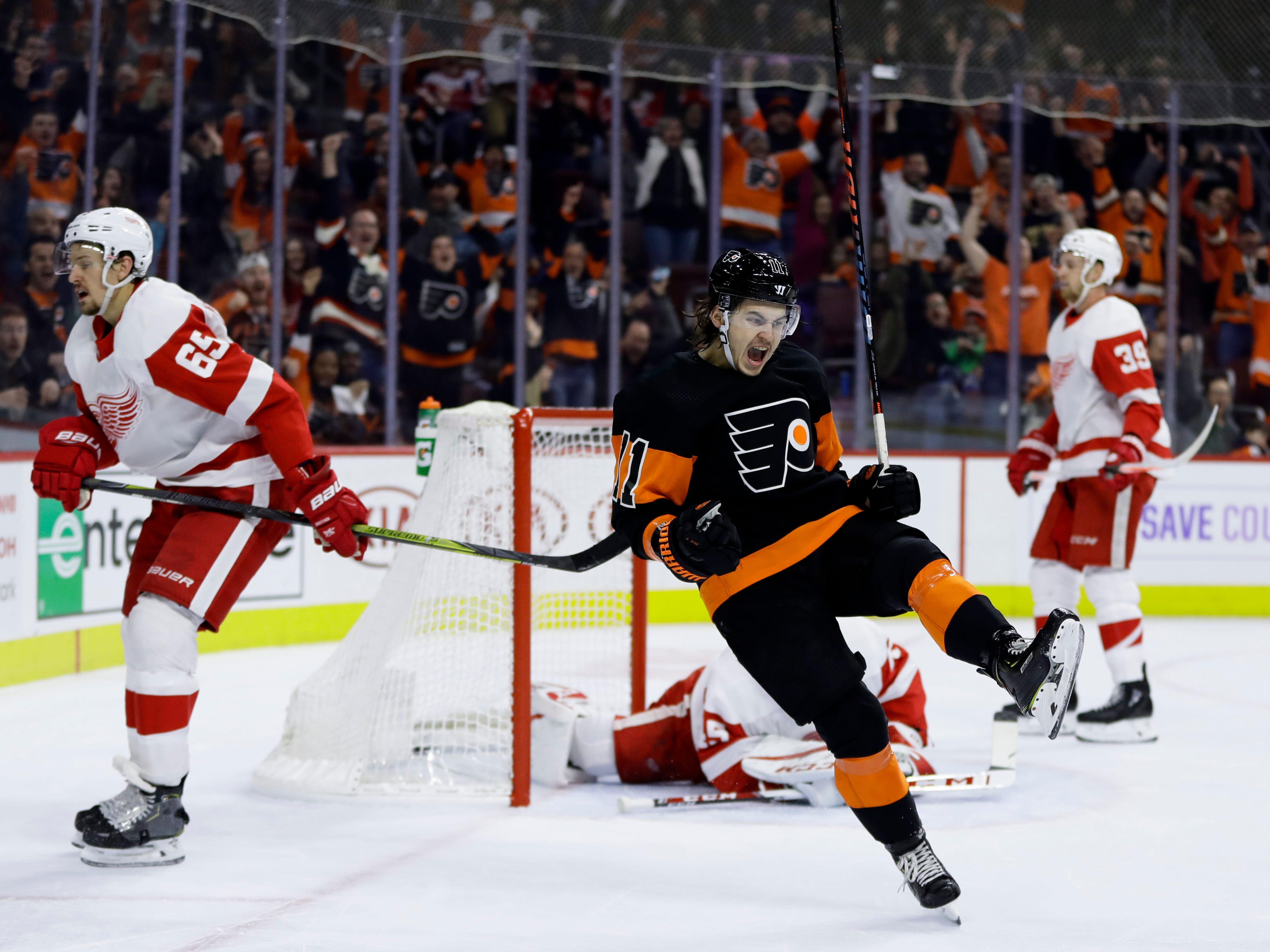 Philadelphia Flyers' Travis Konecny (11) celebrates after scoring the game-winning goal during overtime of an NHL hockey game against the Detroit Red Wings, Saturday, Feb. 16, 2019, in Philadelphia. The Flyers won 6-5. (AP Photo/Matt Slocum)