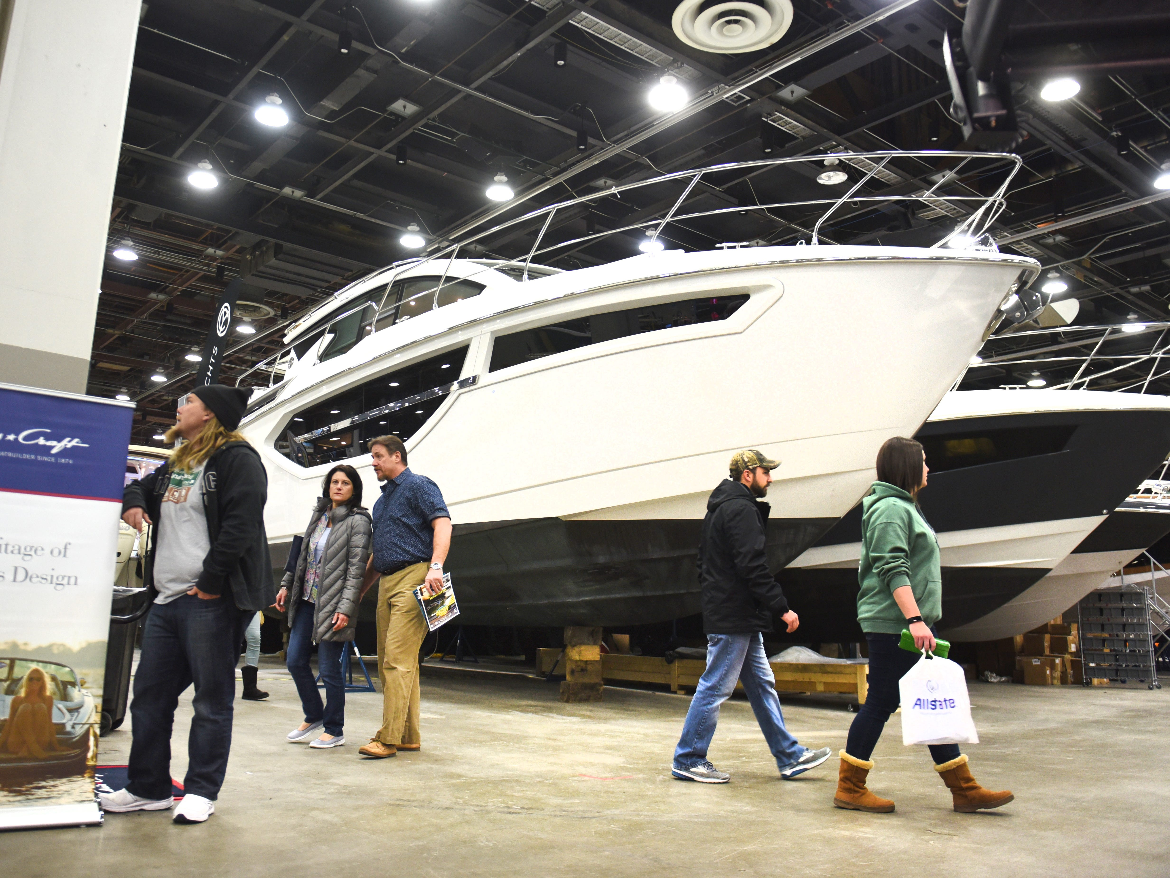 People walk passed a Skiipper Bud's  2019 42 Cantius Cruiser Yacht at the Detroit Boat Show at Cobo Center on Saturday, February 16, 2018.