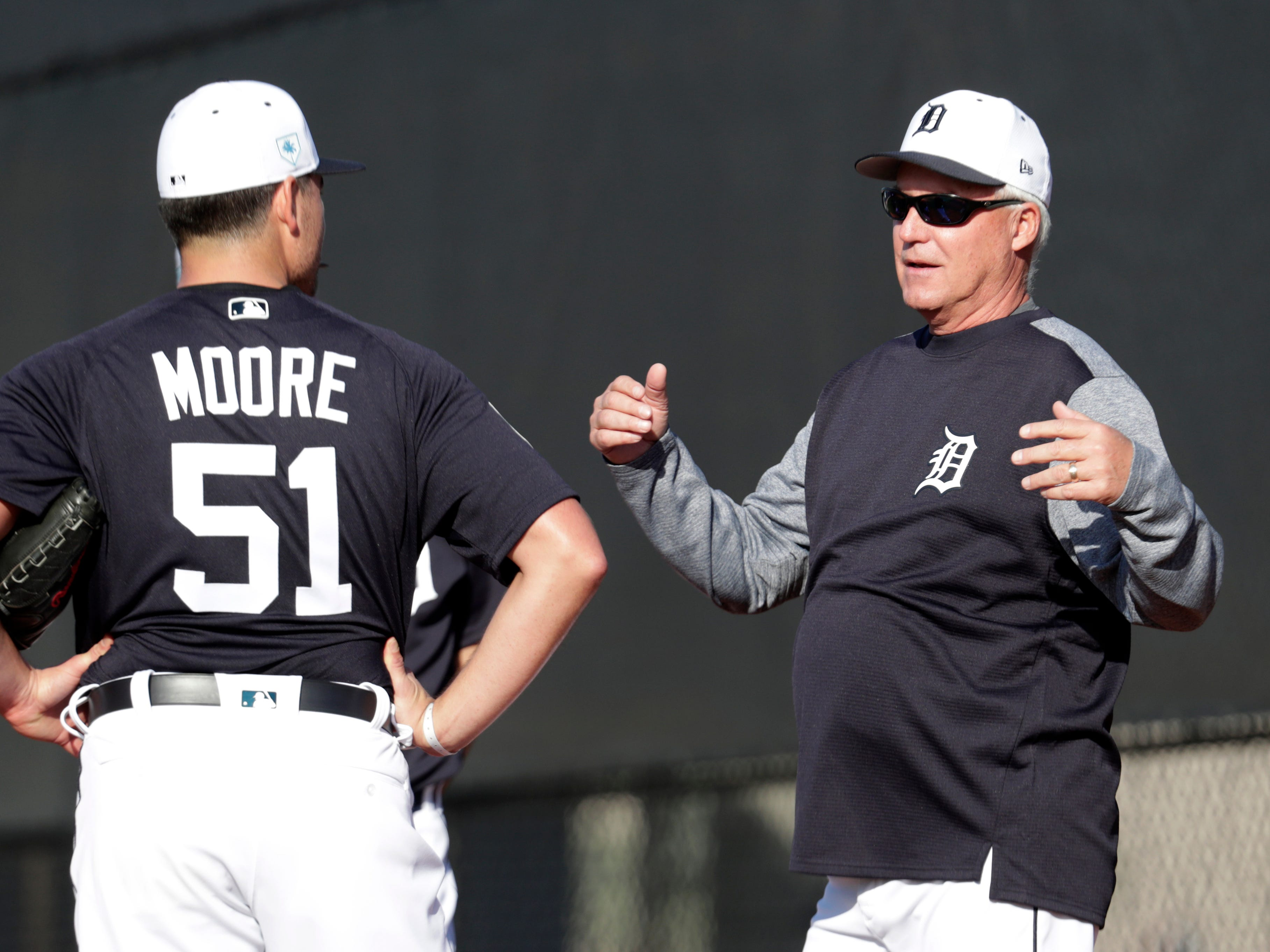 Detroit Tigers pitching coach Rick Anderson, right, talk with pitcher Matt Moore.
