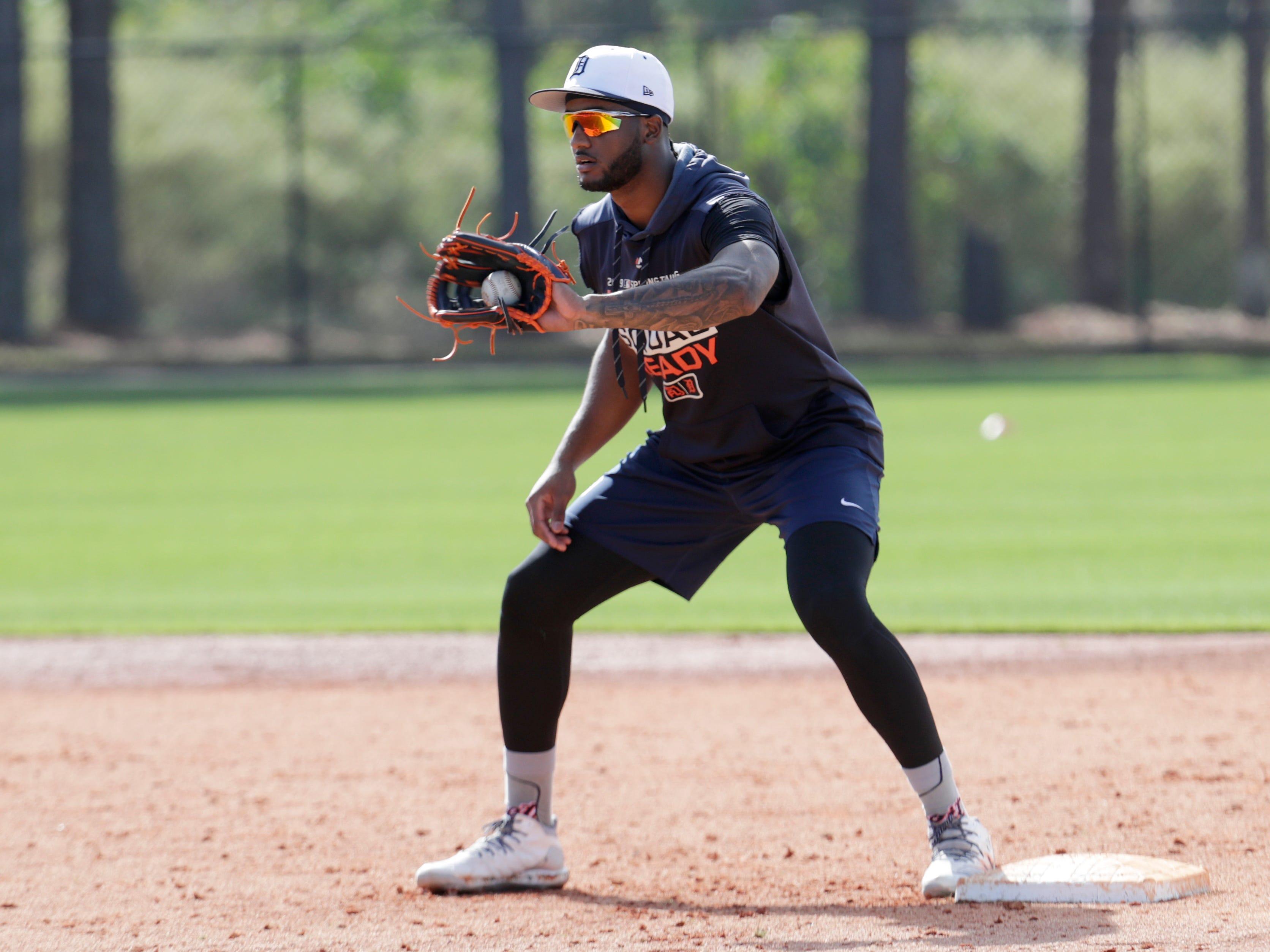 Detroit Tigers infielder Niko Goodrum does drills.