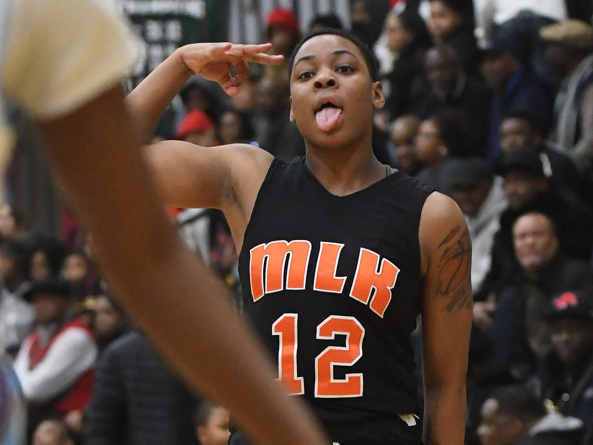 King's Charellle Mathis celebrates a 3-point play in the second half.