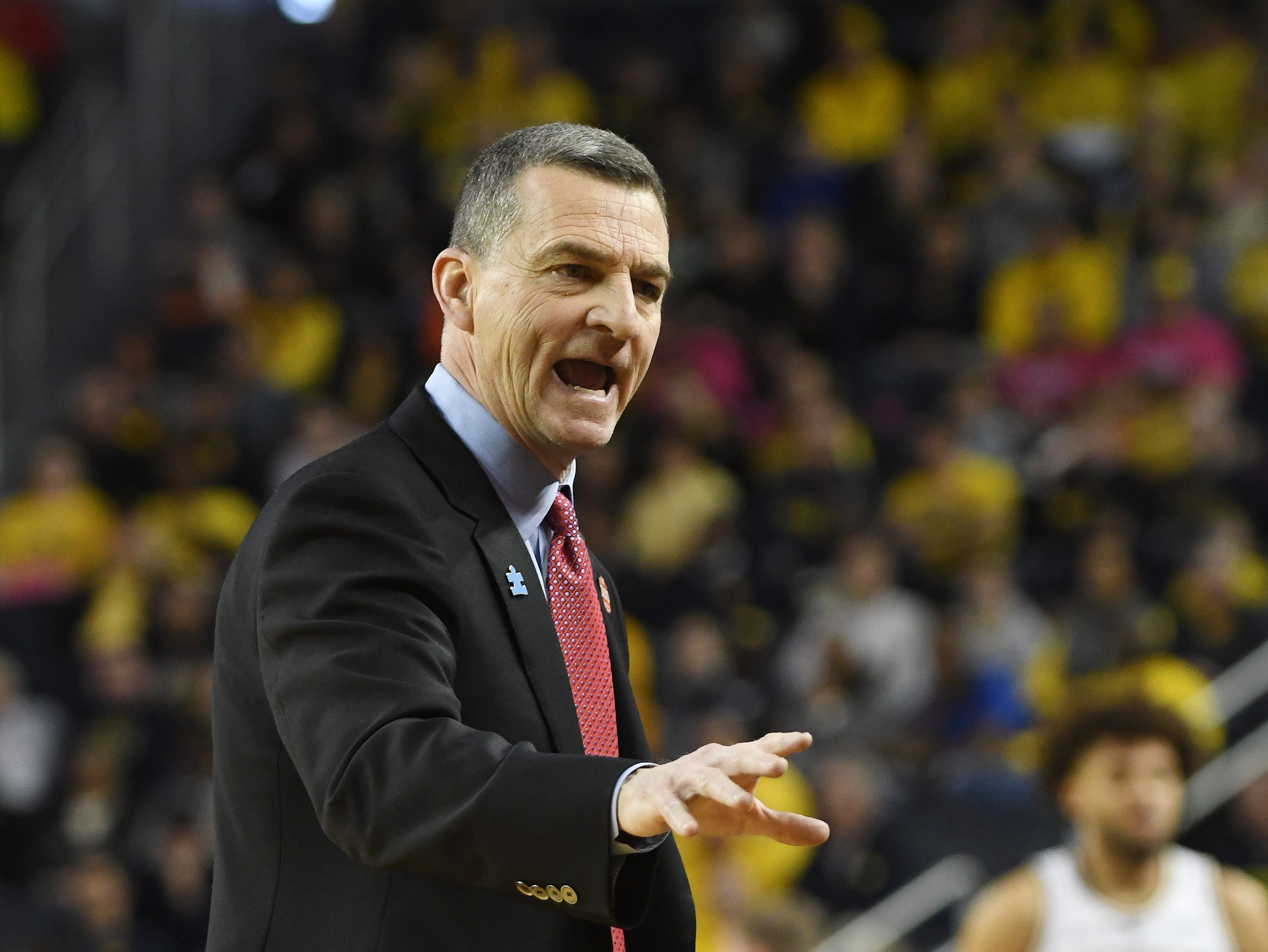 Maryland basketball coach Mark Turgeon works the sidelines in the first half.