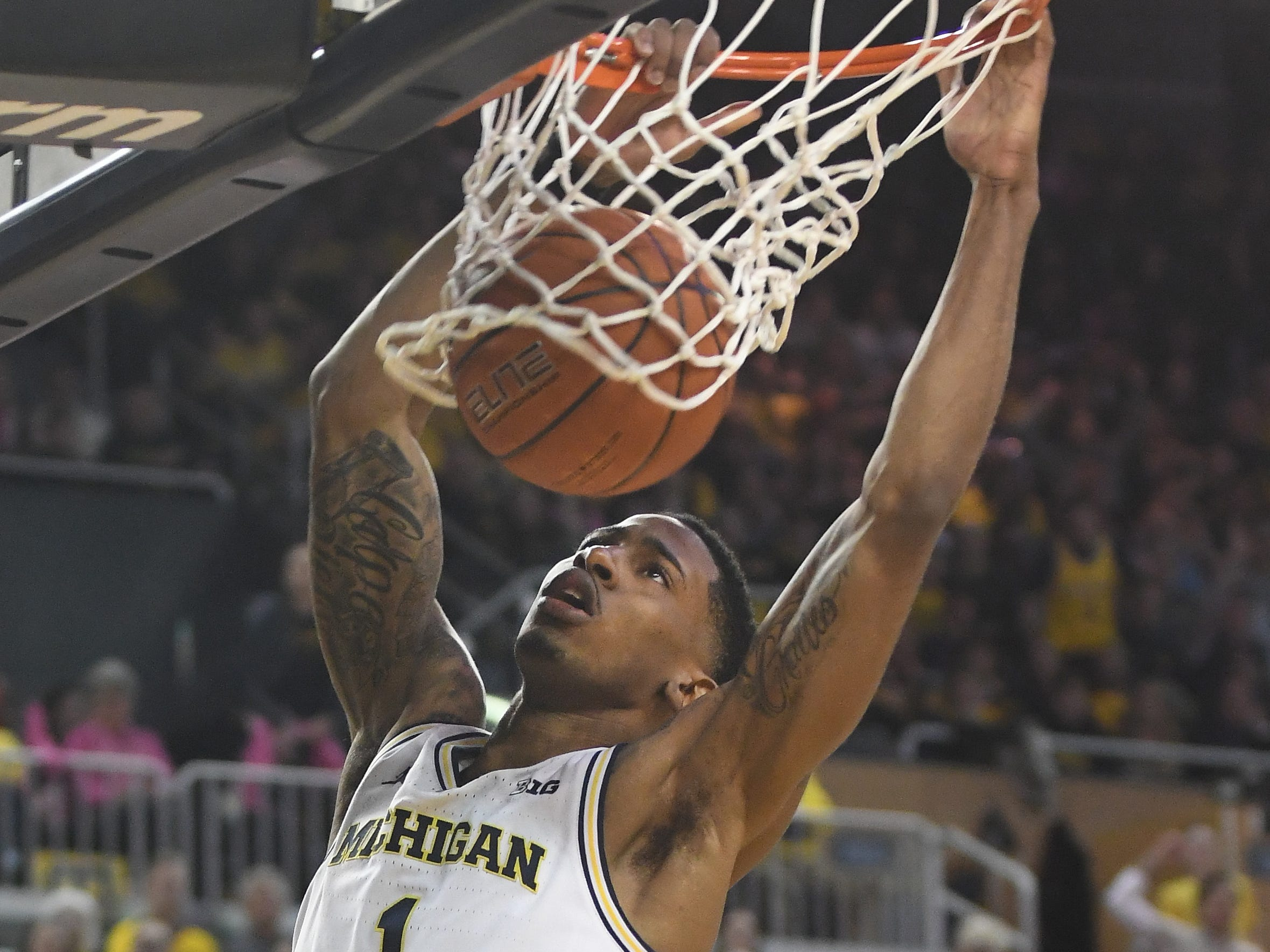 Michigan's Charles Matthews puts home another slam dunk, this one in the second half.