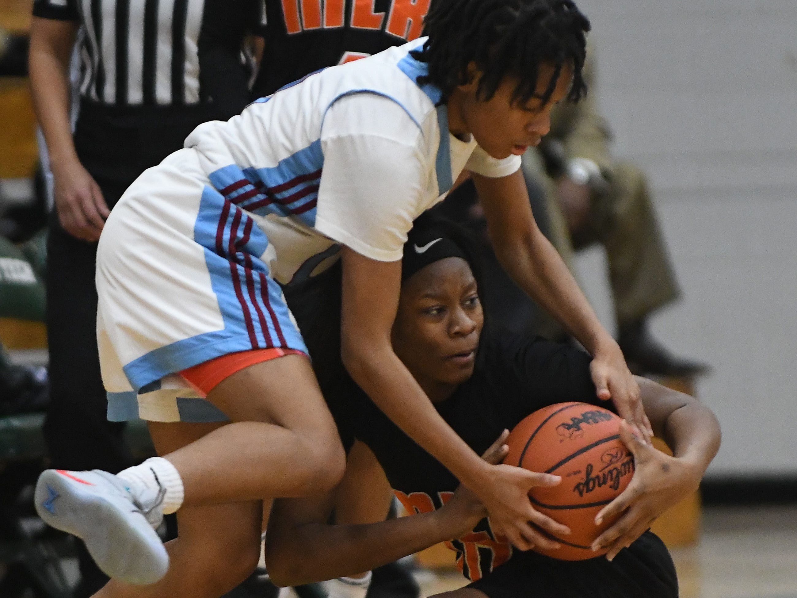 Mumford's Tiaira Earnest and King's Jaden Alexander battle for a loose ball in the first half.