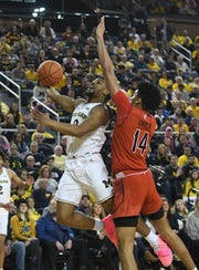 Michigan's David DeJulius drives to the basket against Maryland's Ricky Lindo Jr. in the first half