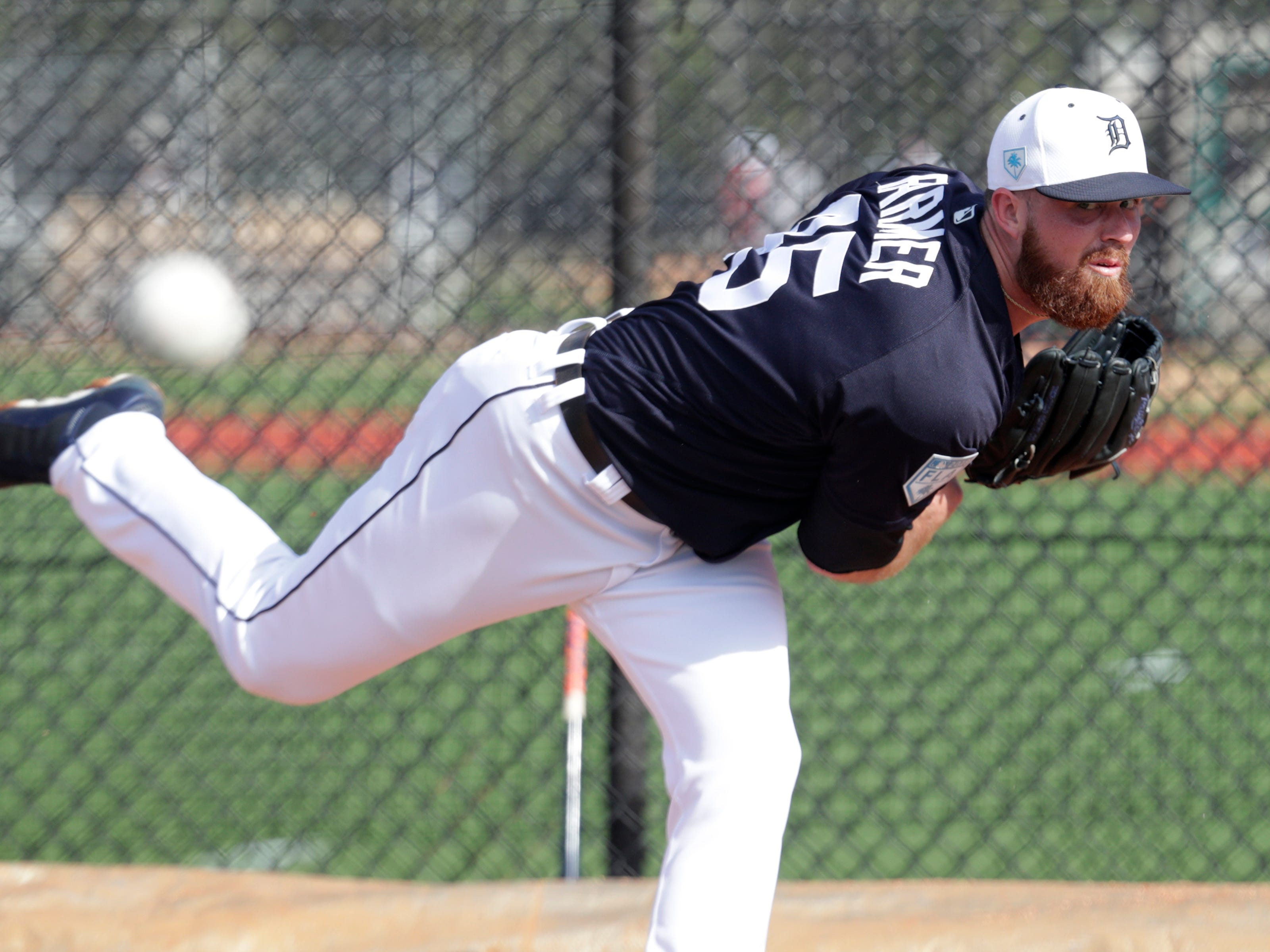 Detroit Tigers relief pitcher Buck Farmer throws in the bullpen.