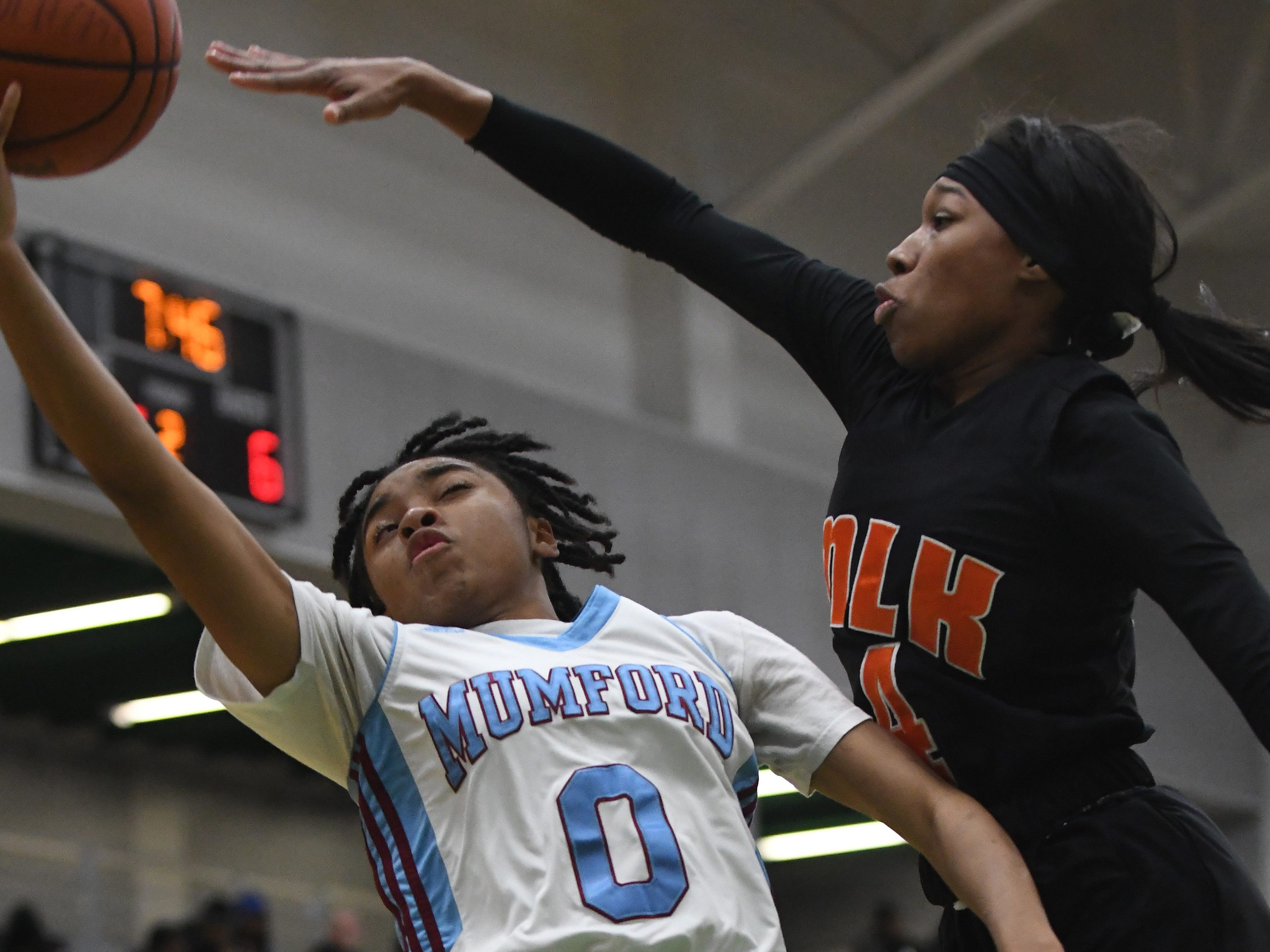 Mumford's Tiaira Earnest puts a shot up against Ford's Del'Janae Williams in the first half.
