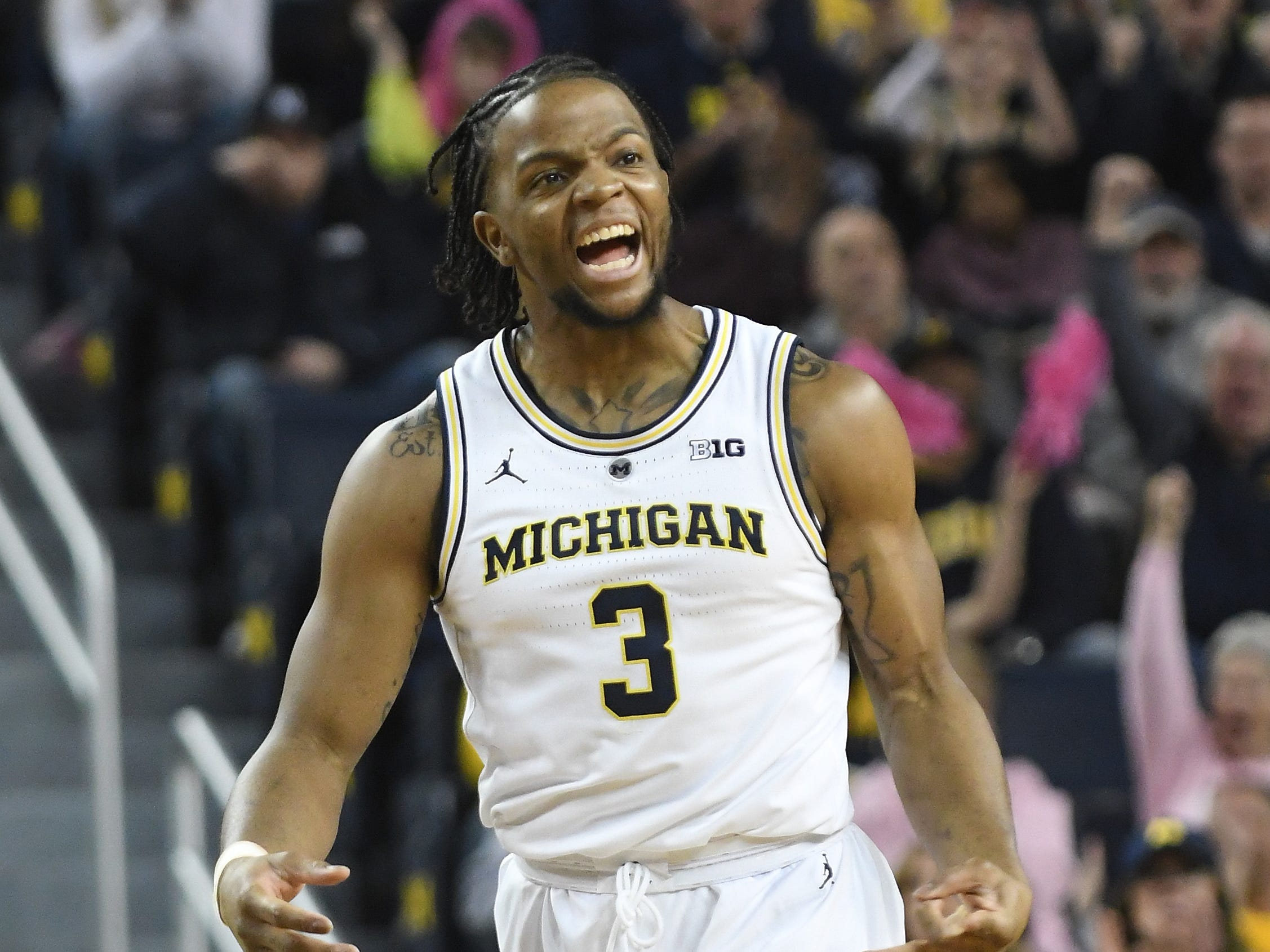 Michigan's Zavier Simpson lets out a yell after assisting in a three point basket in the first half 65-52 victory over Maryland at Crisler Center in Ann Arbor, Michigan on February 16, 2019.