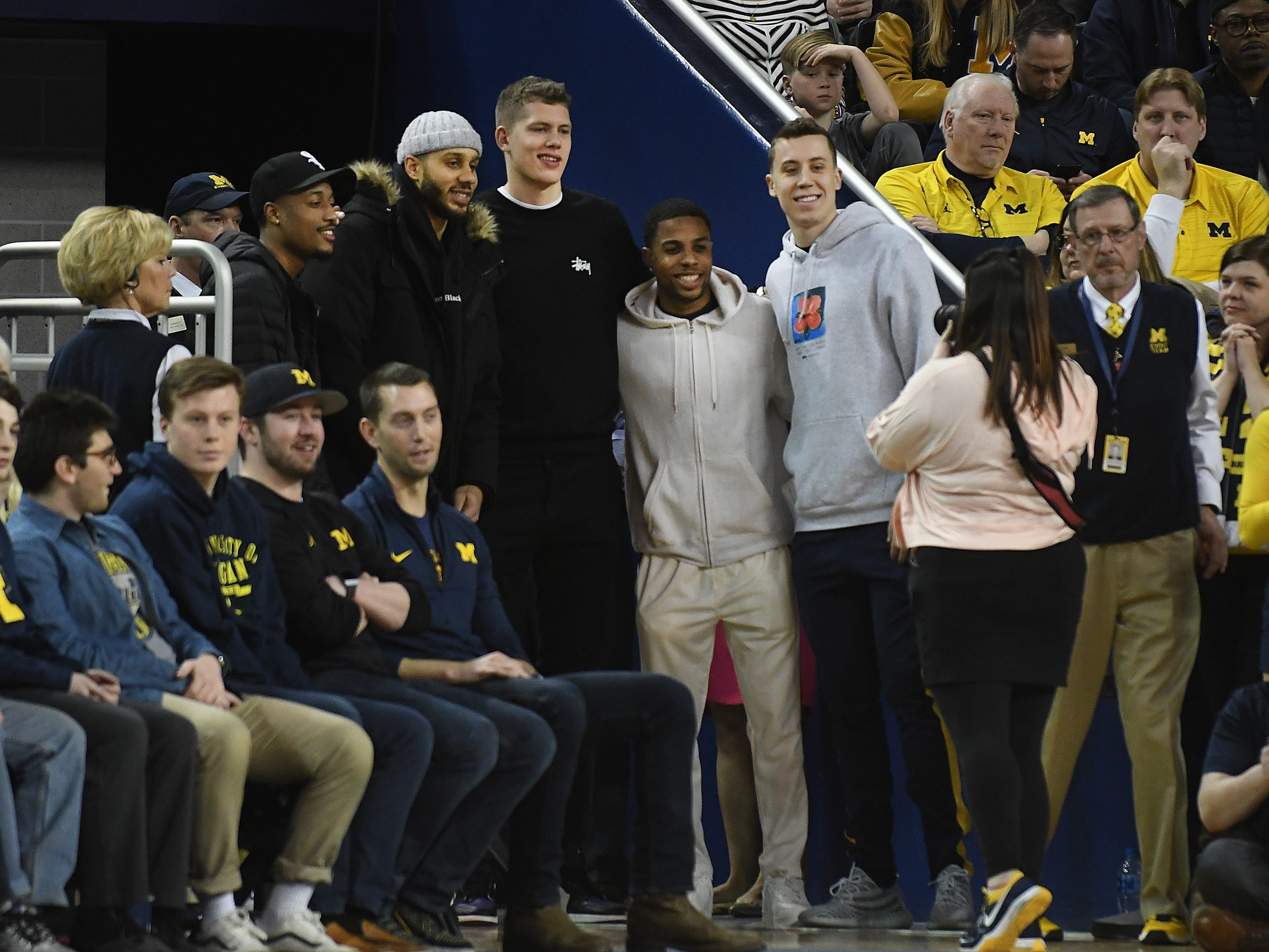 Former Michigan basketball players Muhammad-Ali Adbur-Rahkman, Jordan Morgan, Moritz Wagner, Jaaron Simmons and Duncan Robinson pose for a picture during a break in the action.