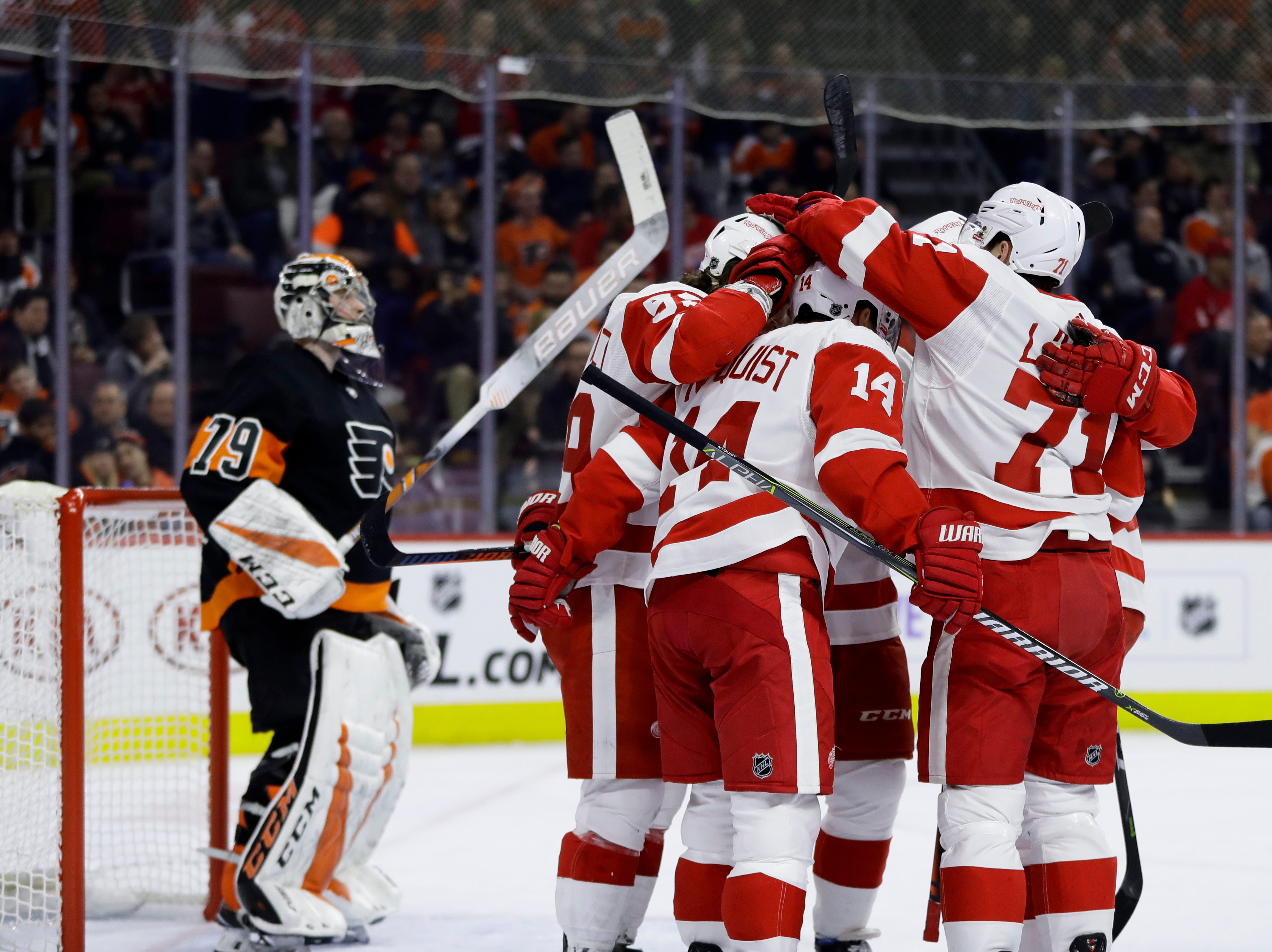 Detroit Red Wings' Gustav Nyquist (14) celebrates with his teammates after scoring a goal against Philadelphia Flyers' Carter Hart (79) during the first period of an NHL hockey game, Saturday, Feb. 16, 2019, in Philadelphia. (AP Photo/Matt Slocum)