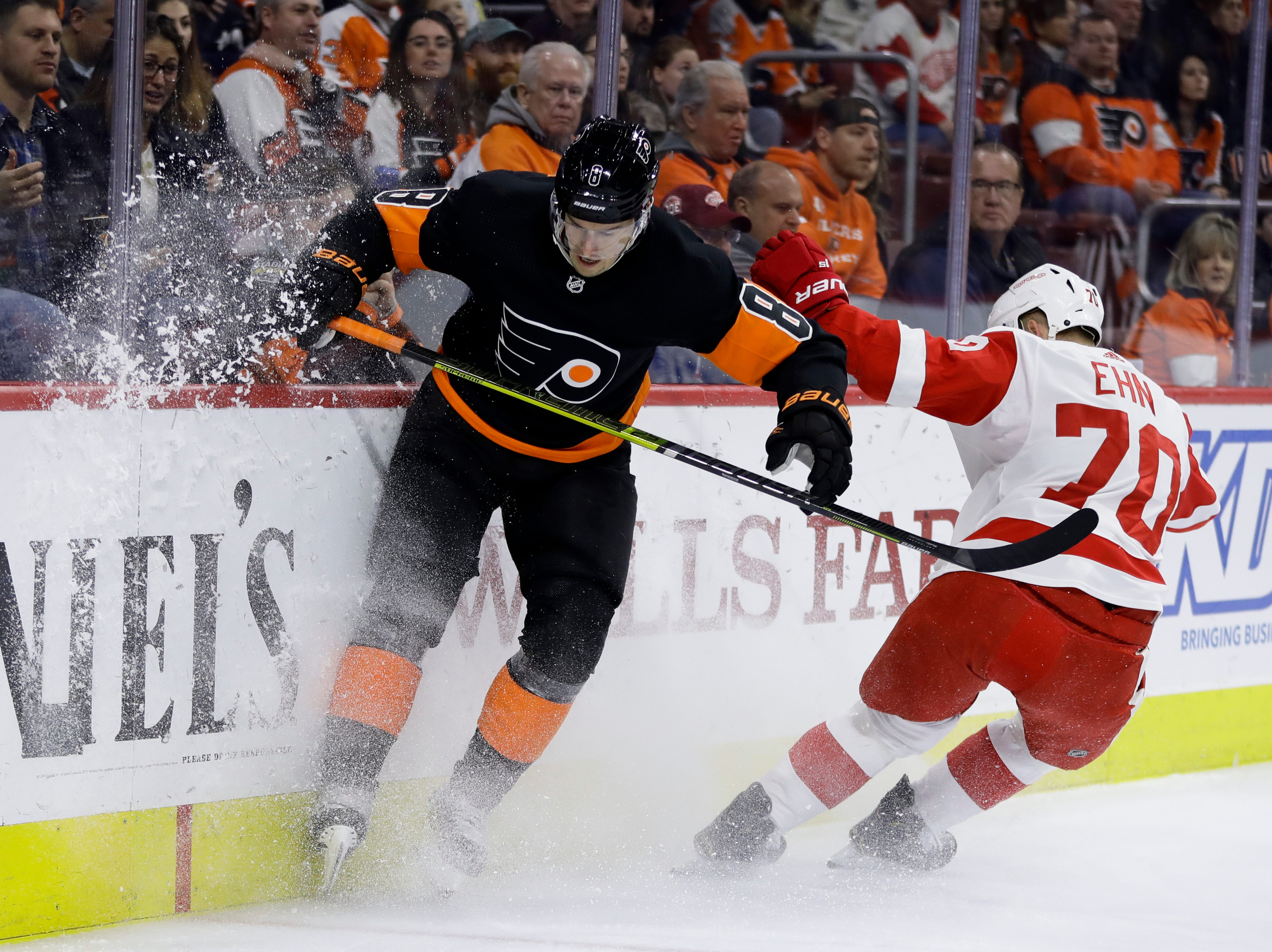 Philadelphia Flyers' Robert Hagg, left, and Detroit Red Wings' Christoffer Ehn chase after a loose puck during the first period of an NHL hockey game, Saturday, Feb. 16, 2019, in Philadelphia. (AP Photo/Matt Slocum)
