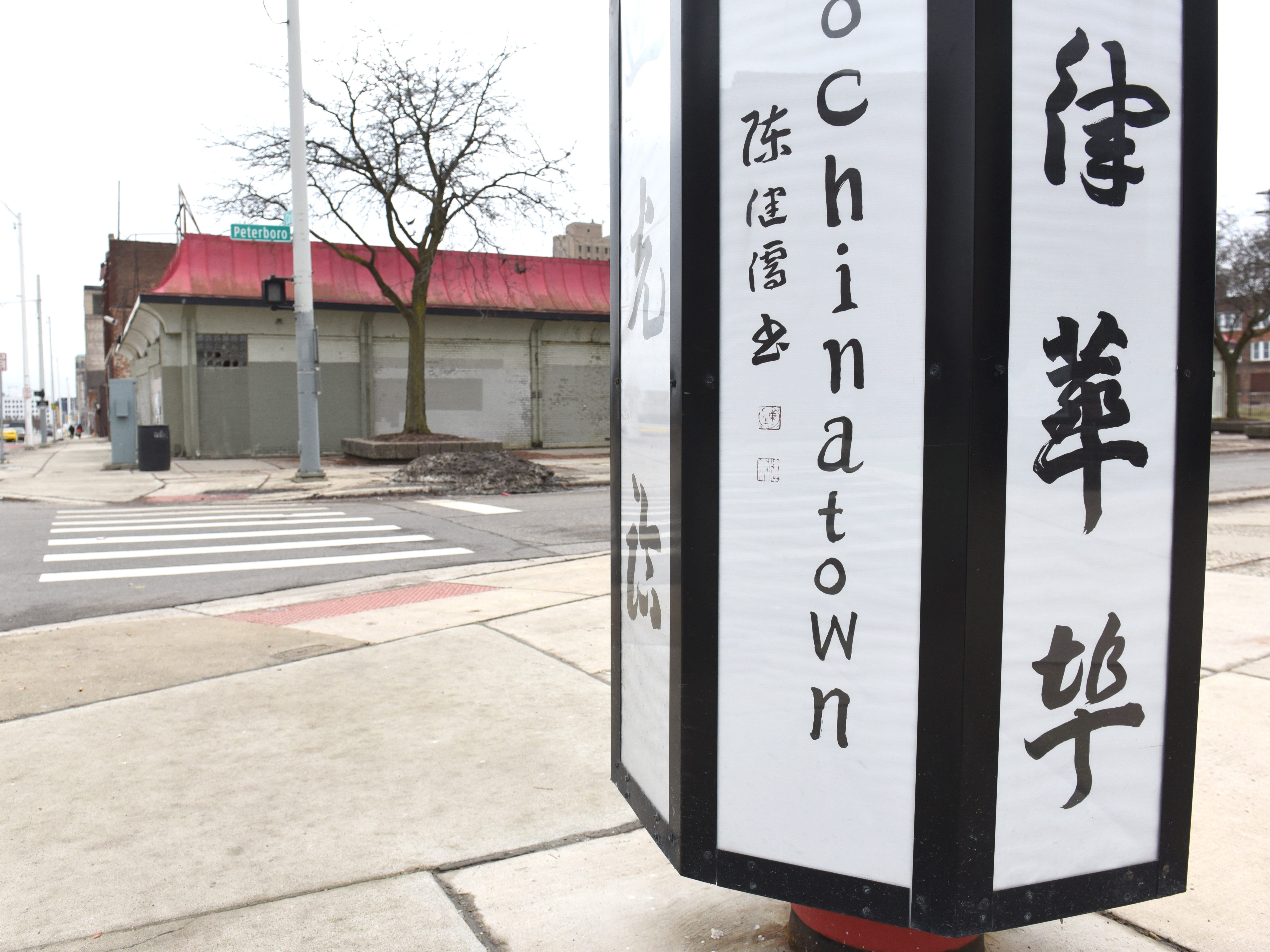 "The original sign has been restored at Peterboro Street and Cass Avenue in Detroit's old ""Chinatown"" area."