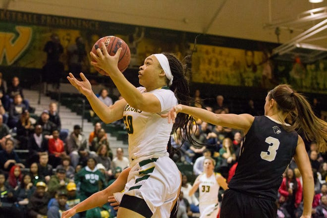 Wayne State senior India Hawkins drives to the basket for two. Hawkins finished with a career-high 22 points in the Warriors' 93-68 victory Saturday.