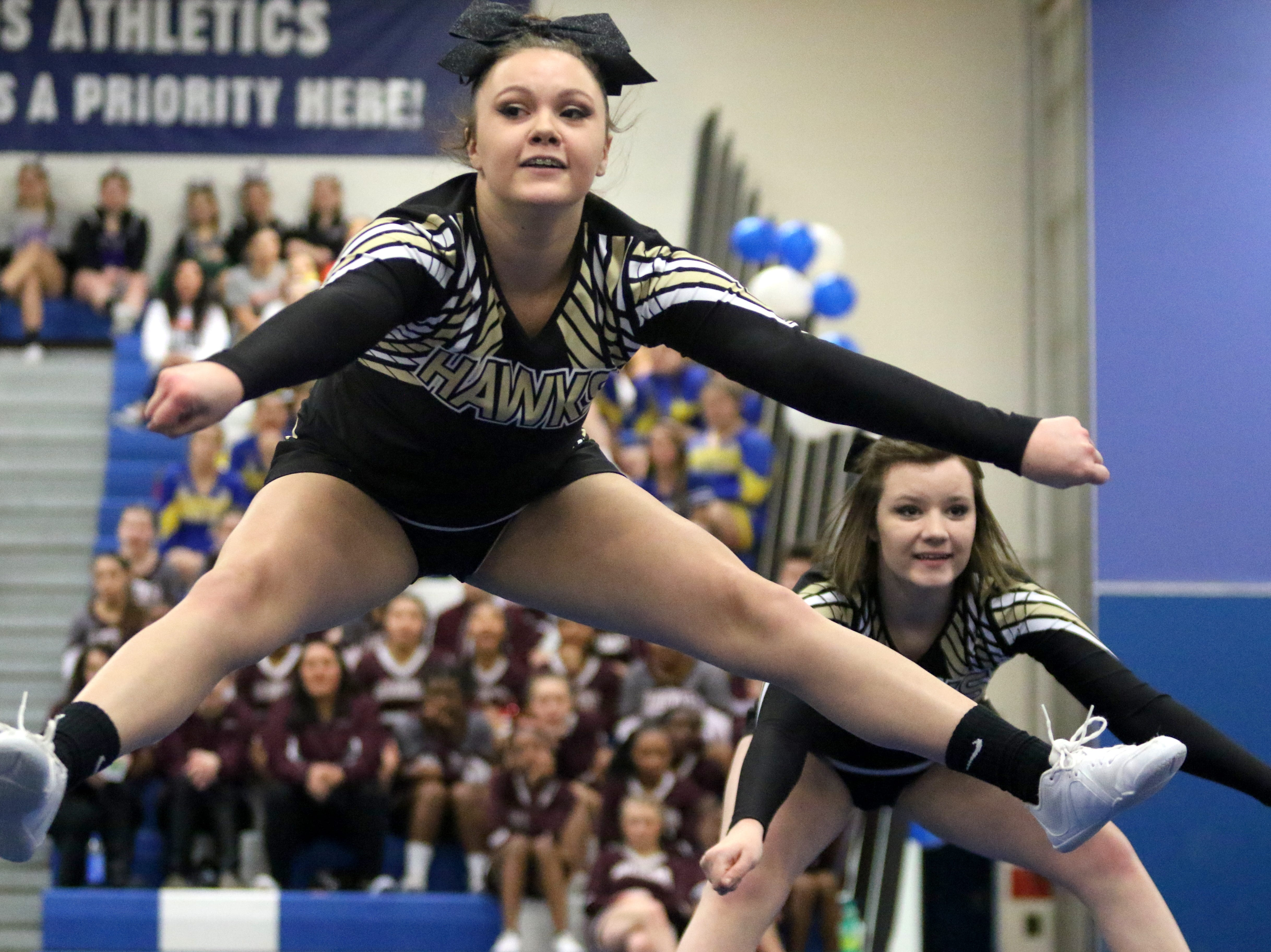 Corning varsity cheerleaders compete at the STAC Winter Cheer Championships on Feb. 16, 2019 at Horseheads Middle School.