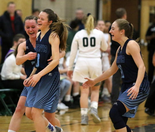 Moravia players, from left, Sierra Lyon, Maddy Kelly and Sophia Amos celebrate their 65-52 victory over Newfield in the IAC Small School girls basketball championship game Feb. 15, 2019 at Tompkins Cortland Community College.