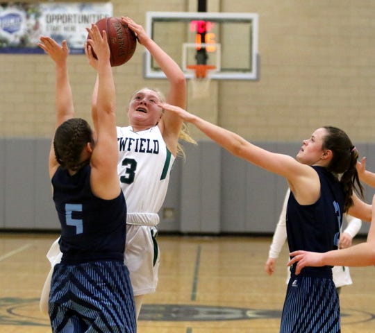 Katie Moravec of Newfield goes up for a shot as Brooke Steger (5) and Maddy Kelly (3) of Moravia defend during the IAC Small School girls basketball championship game Feb. 15, 2019 at Tompkins Cortland Community College.