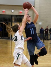Gabby Kehoe of Moravia goes up for a shot as Maura Wood-Ellis defends for Newfield during the IAC Small School girls basketball championship game Feb. 15, 2019 at Tompkins Cortland Community College.