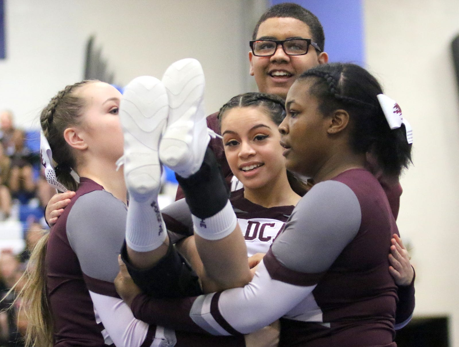 Johnson City varsity cheerleaders compete at the STAC Winter Cheer Championships on Feb. 16, 2019 at Horseheads Middle School.
