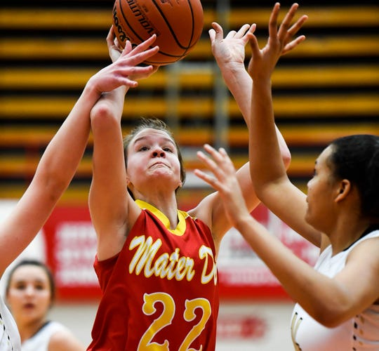 Mater Dei's Jossie Hudson (22) was under defensive pressure from Winchester's Kira Robinson (14) in the Wildcats' 59-50 loss in the Class 2A Jeffersonville Semistate. Hudson had team-highs in points (14) and rebounds (eight).