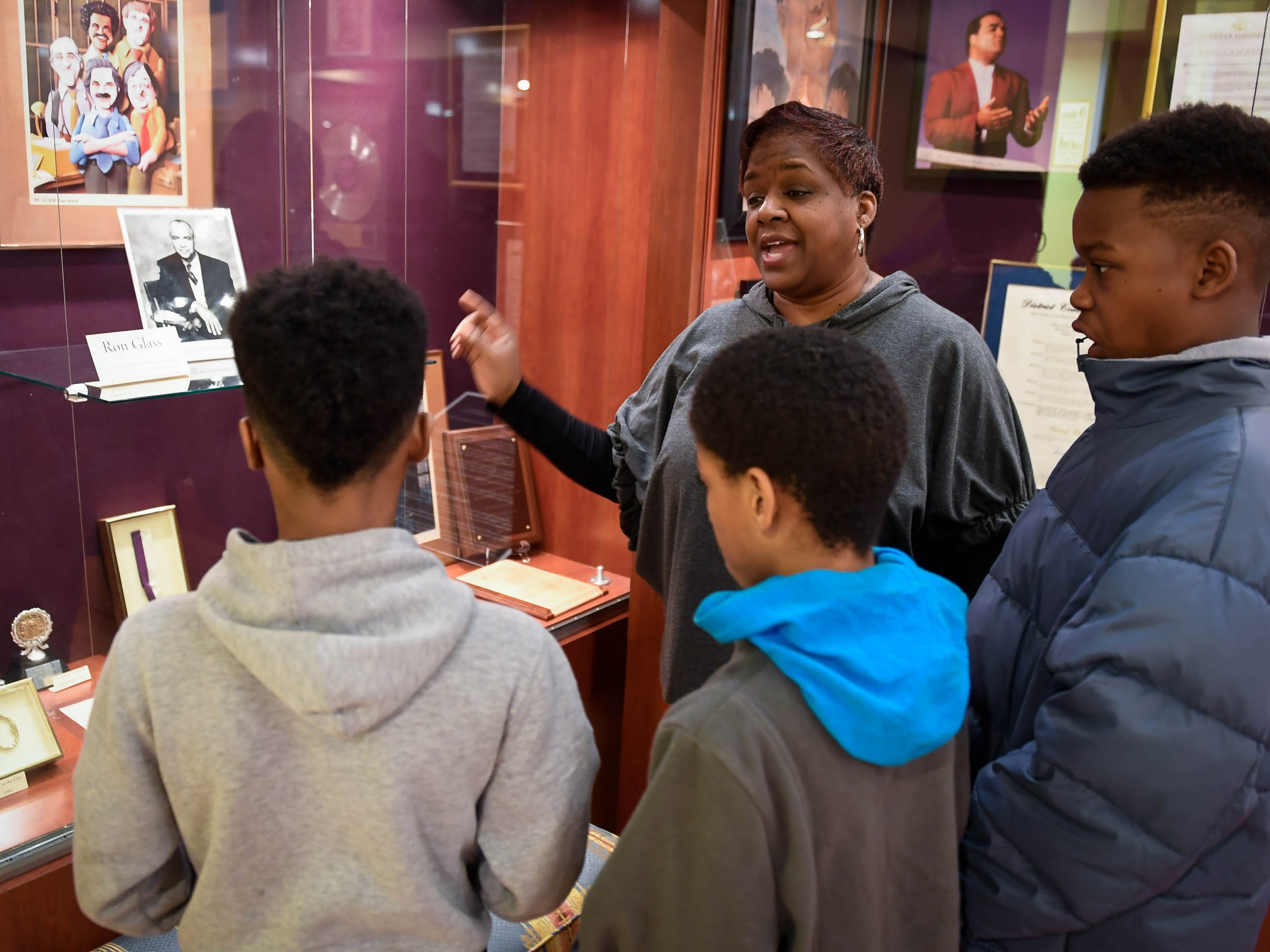 Dexter Elementary teacher, Lynne Farmer, talks about a display on University of Evansville graduate and television personality Ron Glass during a tour by the school's fifth graders of the Evansville African American Museum Friday, February 15, 2019.