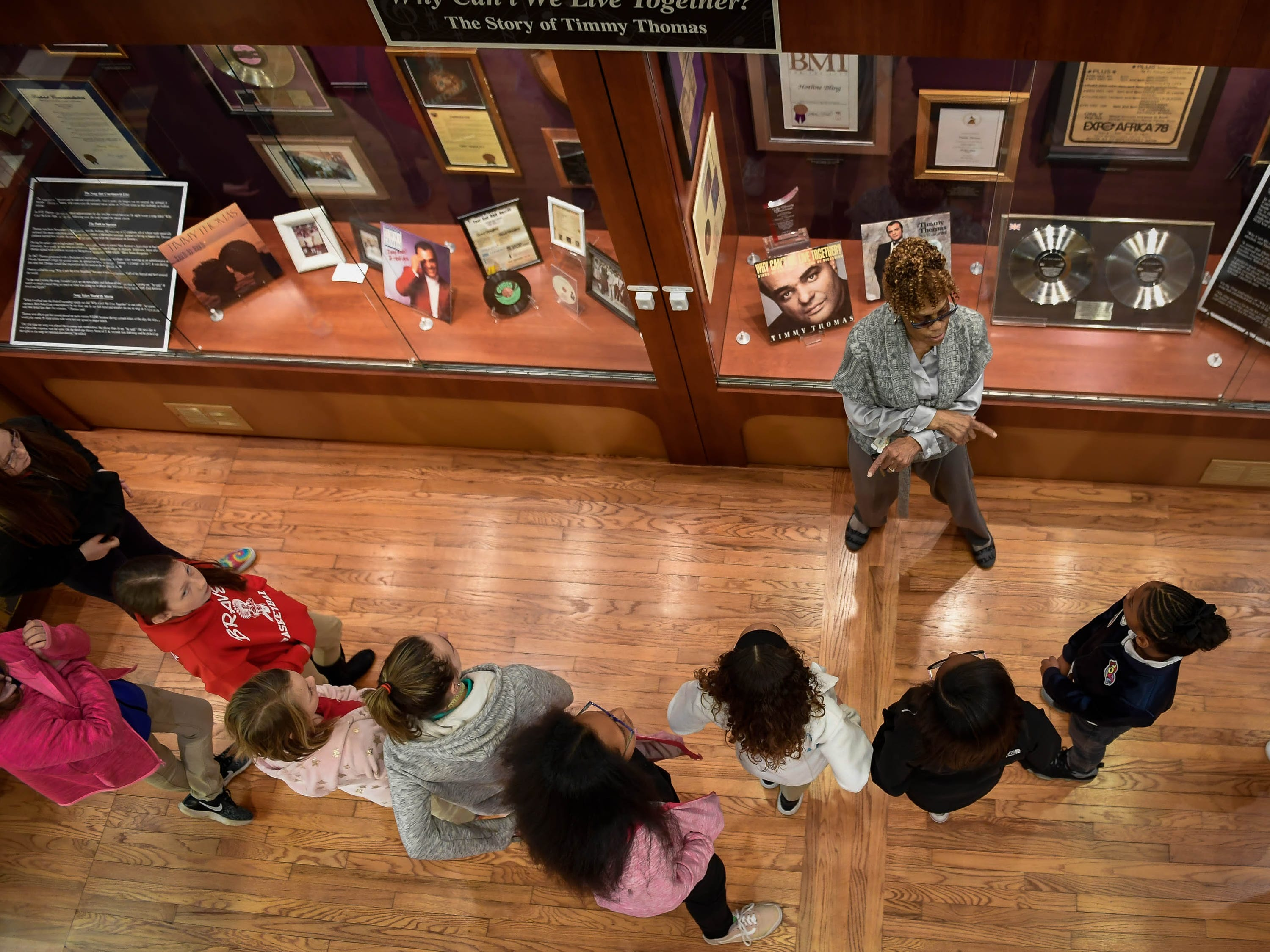Standing in front of a display honoring local Rhythm and Blues singer Timmy Thomas, museum worker Janice Hale leads a group of Dexter Elementary fifth graders on a tour of the Evansville African American Museum on Lincoln Avenue Friday, February 15, 2019.